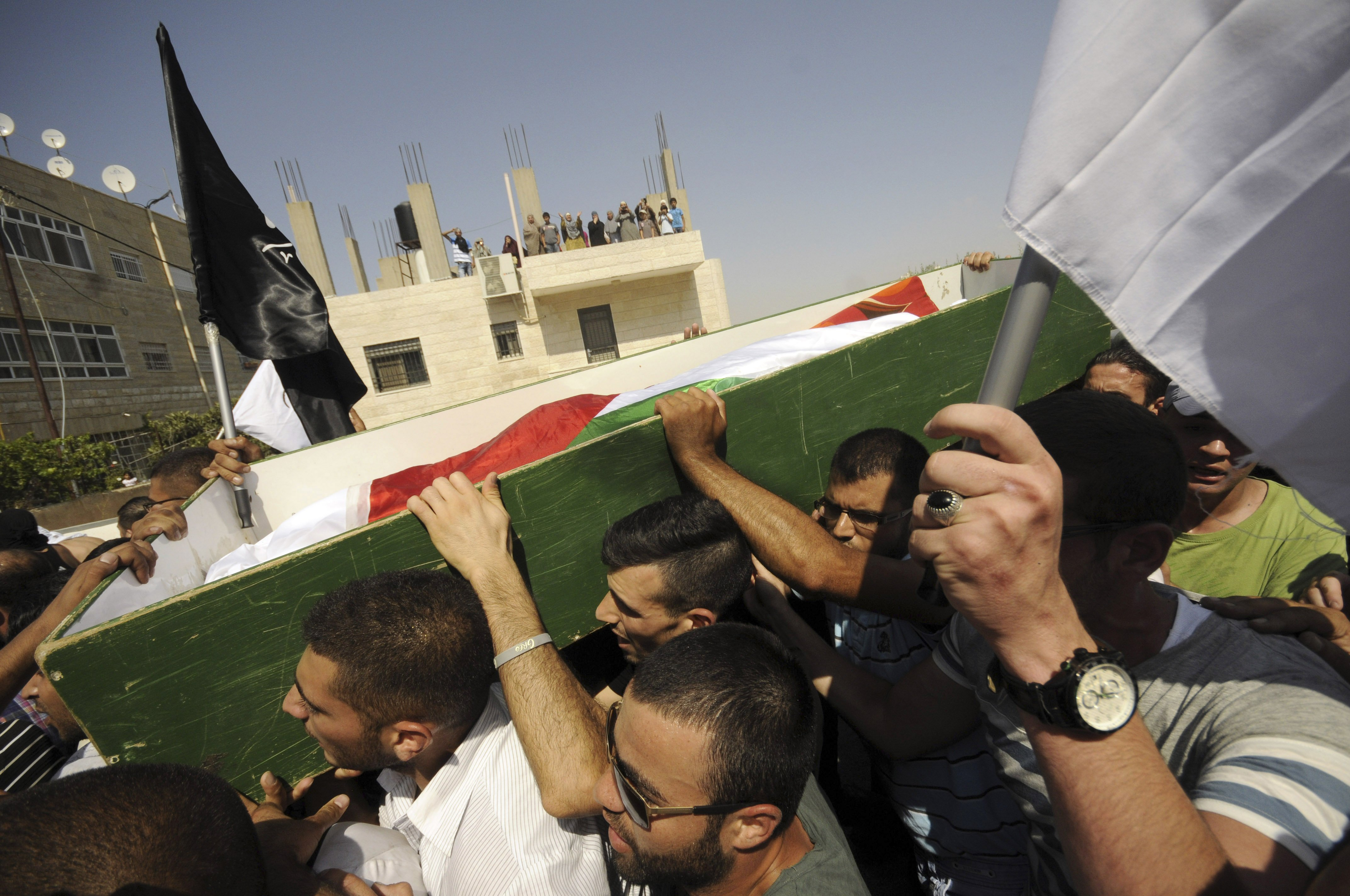 Palestinians carry the body of 16-year-old Mohammed Abu Khdeir in Jerusalem on Friday, July 4, 2014.
