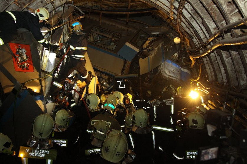Russian rescuers working at the site of an accident between the Park Pobedy and Slavyansky Boulevard metro stations in Moscow, July 15, 2014.