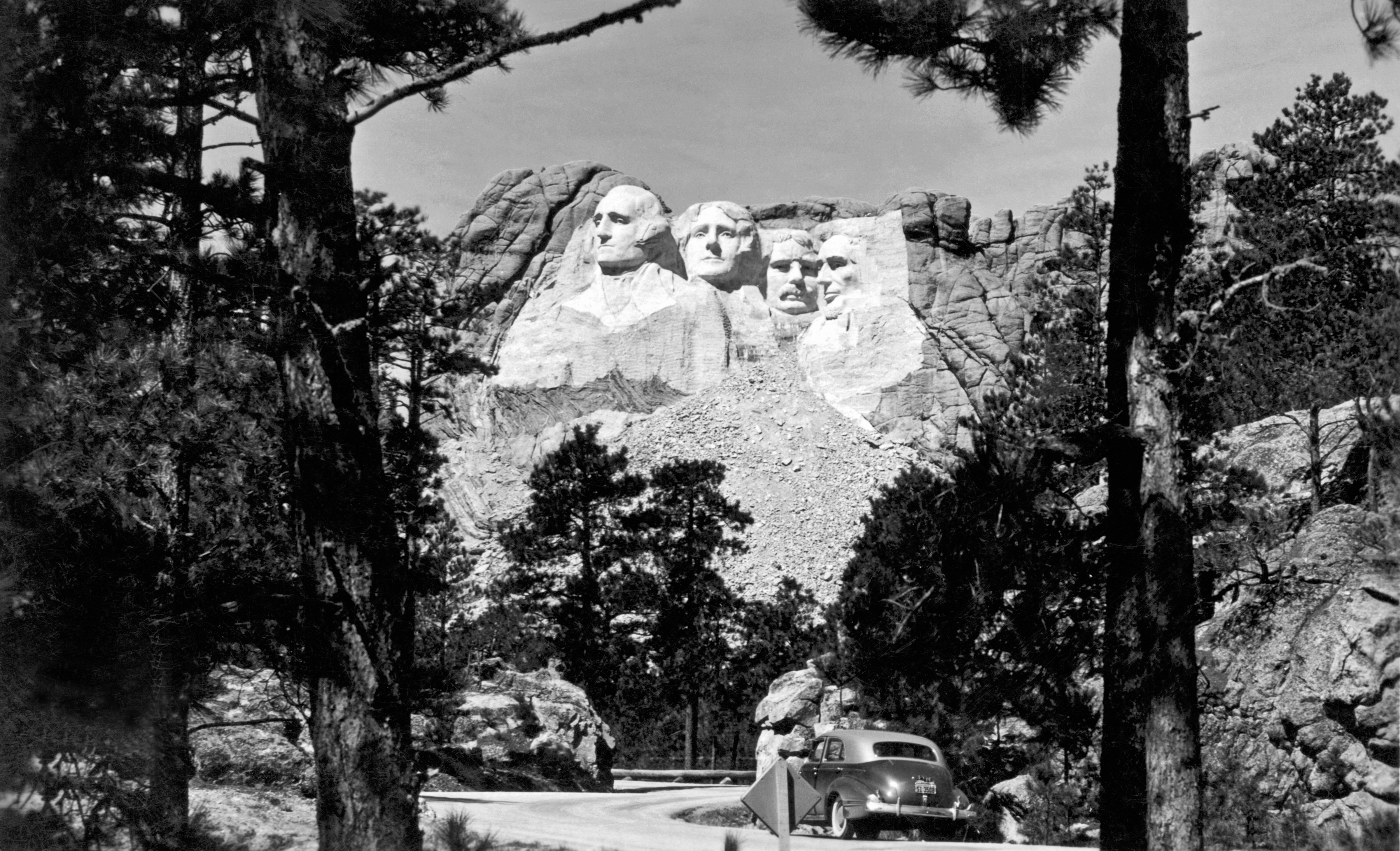 The finished Mount Rushmore sculpture by Guzon Borglum, in the Black Hills area of Keystone, S.D., circa early 1940s.