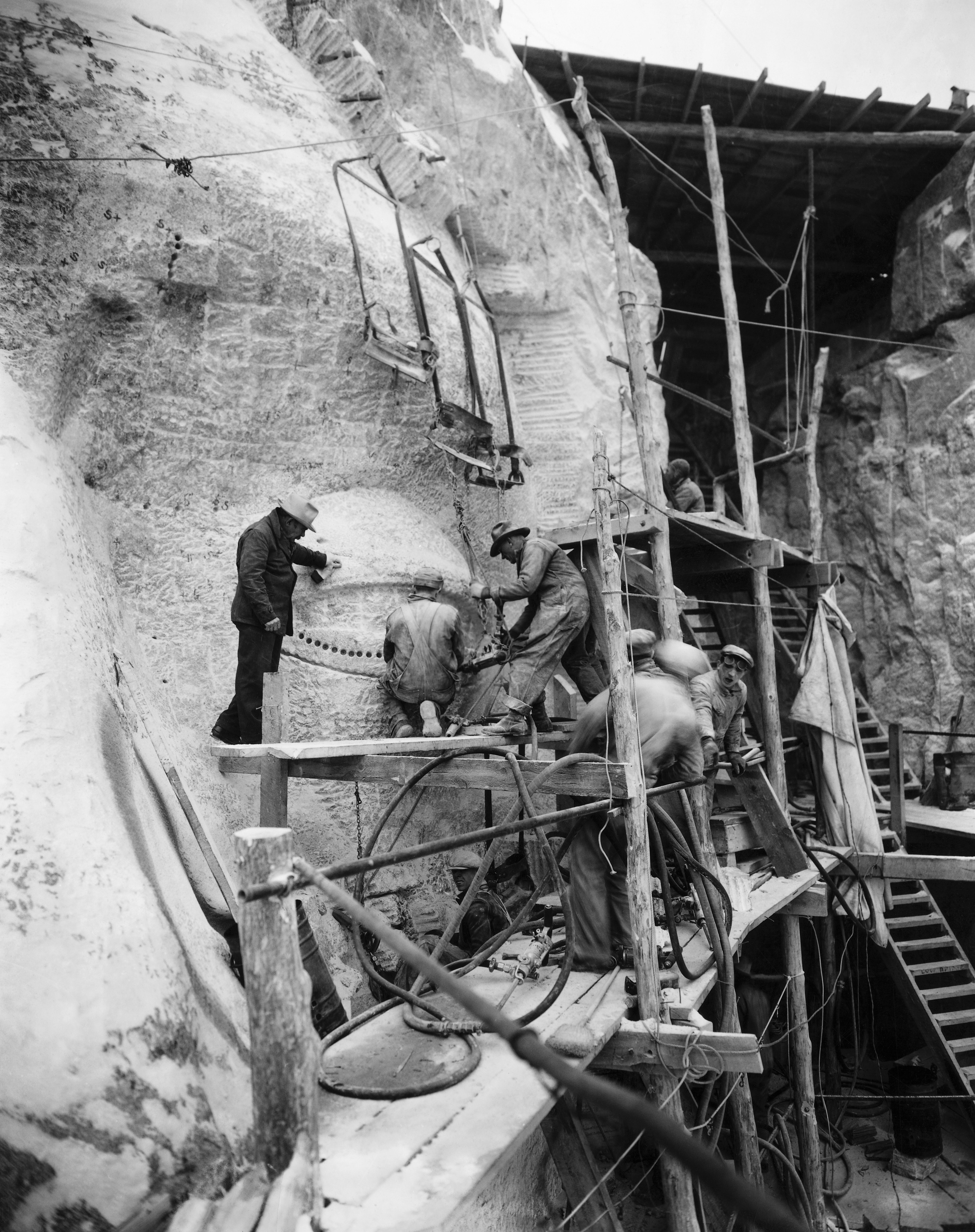 Oculists  at work on Jefferson's eye while Gutzon Borglum inspects the operation in the Black Hills area of Keystone, S.D., circa 1930s.