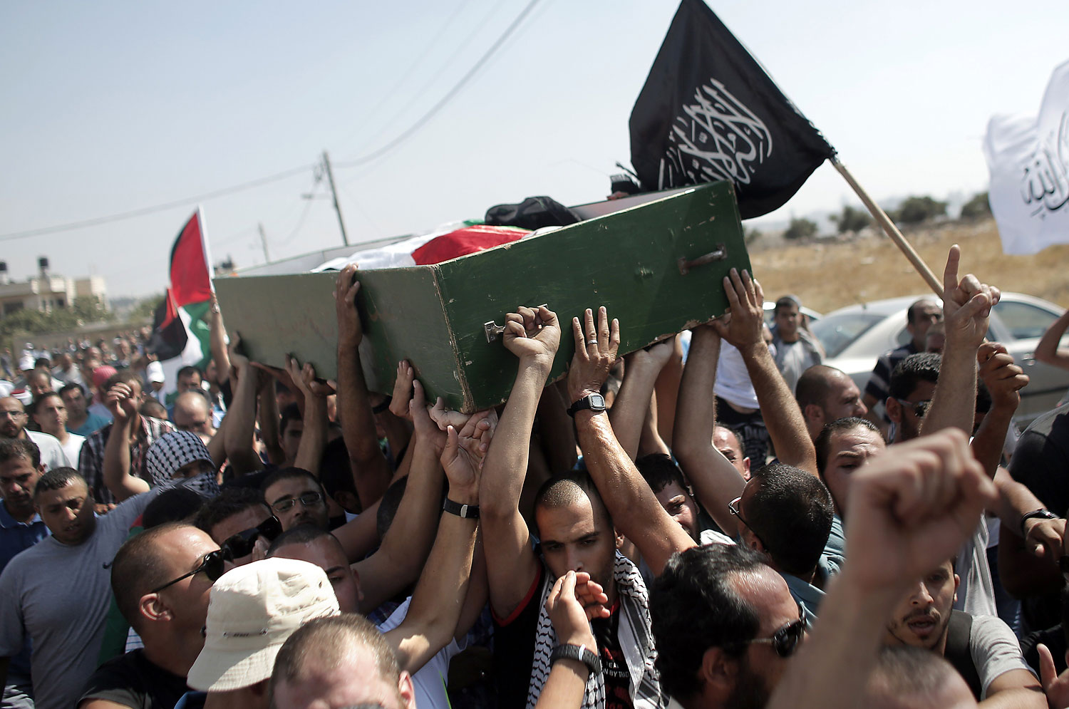 Relatives and friends of Mohammed Abu Khder, 16, carry his body to a mosque during his funeral in Shuafat, in Israeli annexed East Jerusalem on July 4, 2014.