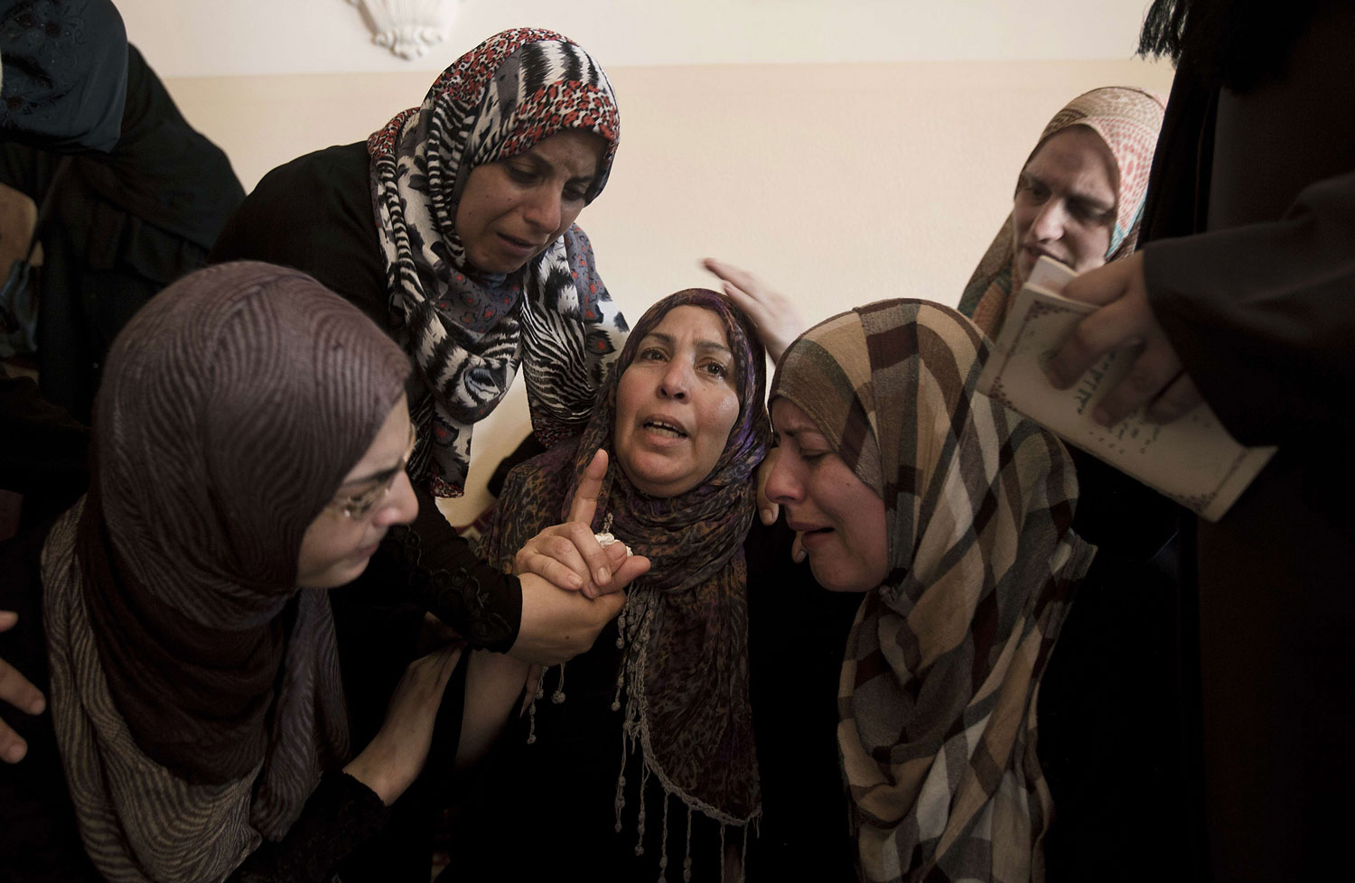 Female relatives of Palestinian Mahmud al-Sewati mourn during his funeral in Gaza City on July 12, 2014.