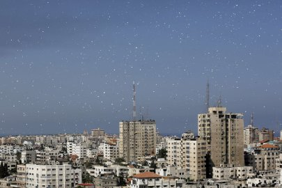 Flyers are dropped over Gaza City by the Israeli army urging residents to evacuate their homes on July 30, 2014.
