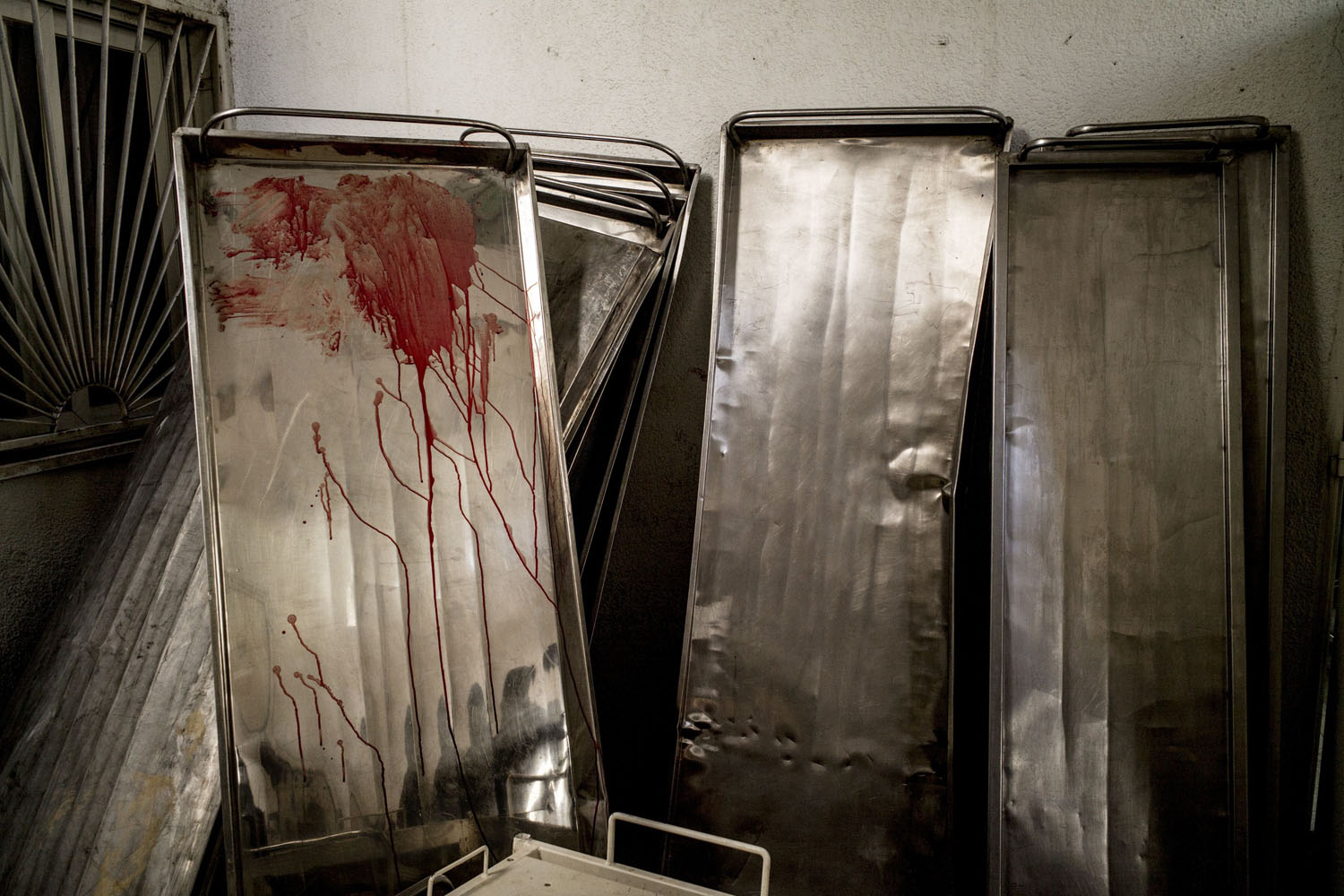 Jul. 30, 2014. Gurneys are seen piled up outside the morgue at the Kamal Adwan hospital in Beit Lahia in the northern Gaza Strip.