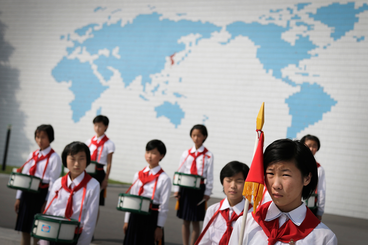 North Korean school girls stand in formation during an opening ceremony for the start of summer activities at the Songdowon International Children's Camp, Tuesday, July 29, 2014, in Wonsan, North Korea.