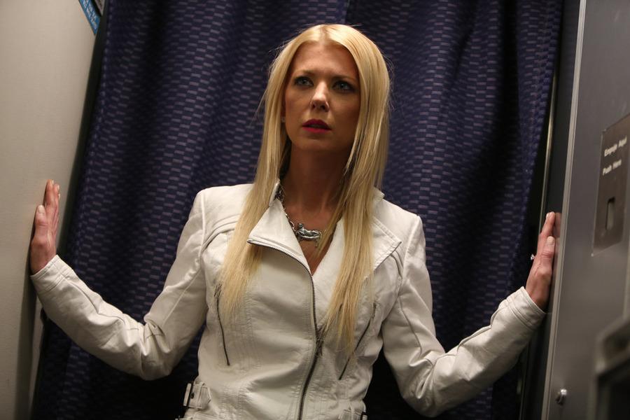 Tara Reid as April Wexler in Sharknado 2: The Second One.