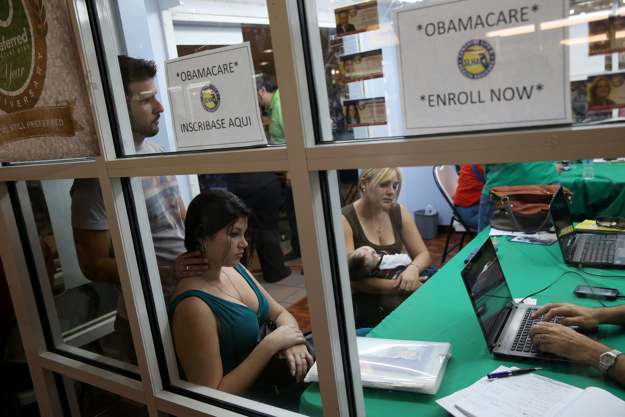 People buying health insurance under the Affordable Care Act at the Mall of Americas on Jan. 15, 2014 in Miami.