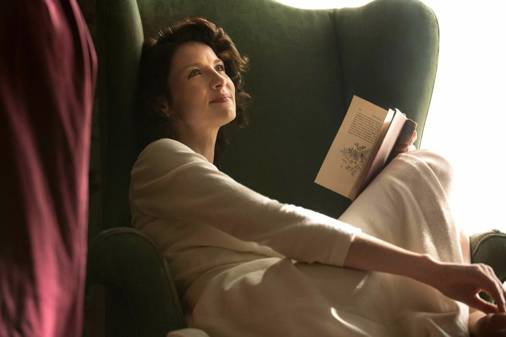 Caitriona Balfe as Claire Randall, transported from 1945 Scotland to 1743 Scotland in Outlander.