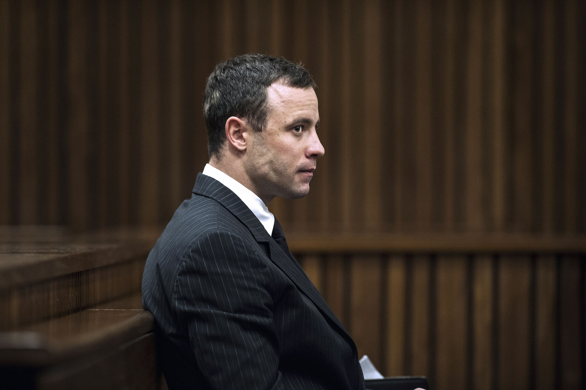 Paralympian Oscar Pistorius sits in the dock during his murder trial at the High Court in Pretoria, on July 2, 2014.