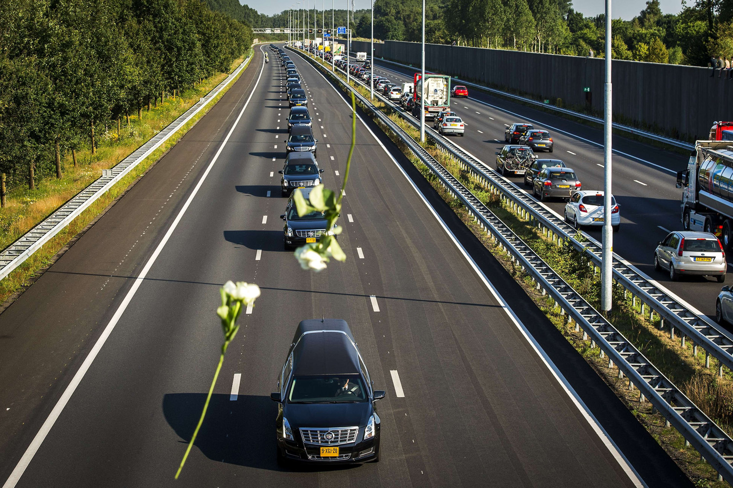 Jul. 23, 2014. A convoy of hearses carrying coffins containing the remains of victims of the downed Malaysia Airlines flight MH17, drives from the Eindhoven Airbase to Hilversum.