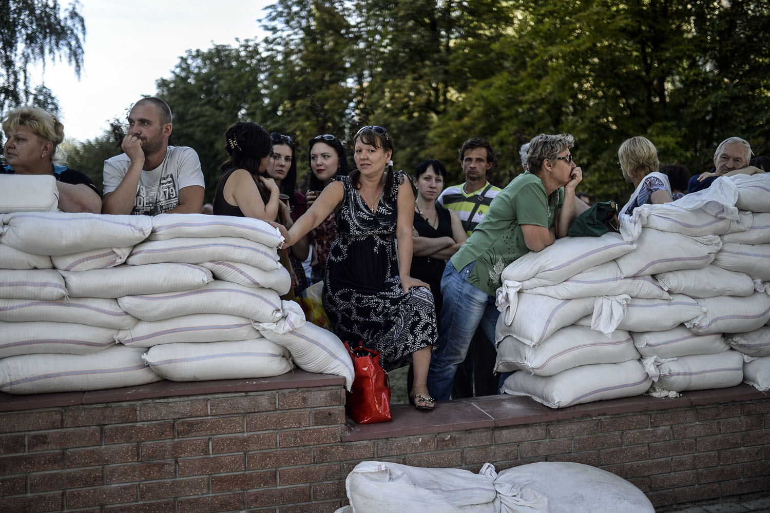 Jul. 28, 2014. Relatives of people detained by separatist Donetsk People's Republic's military wait outside of the military building in Donetsk.
