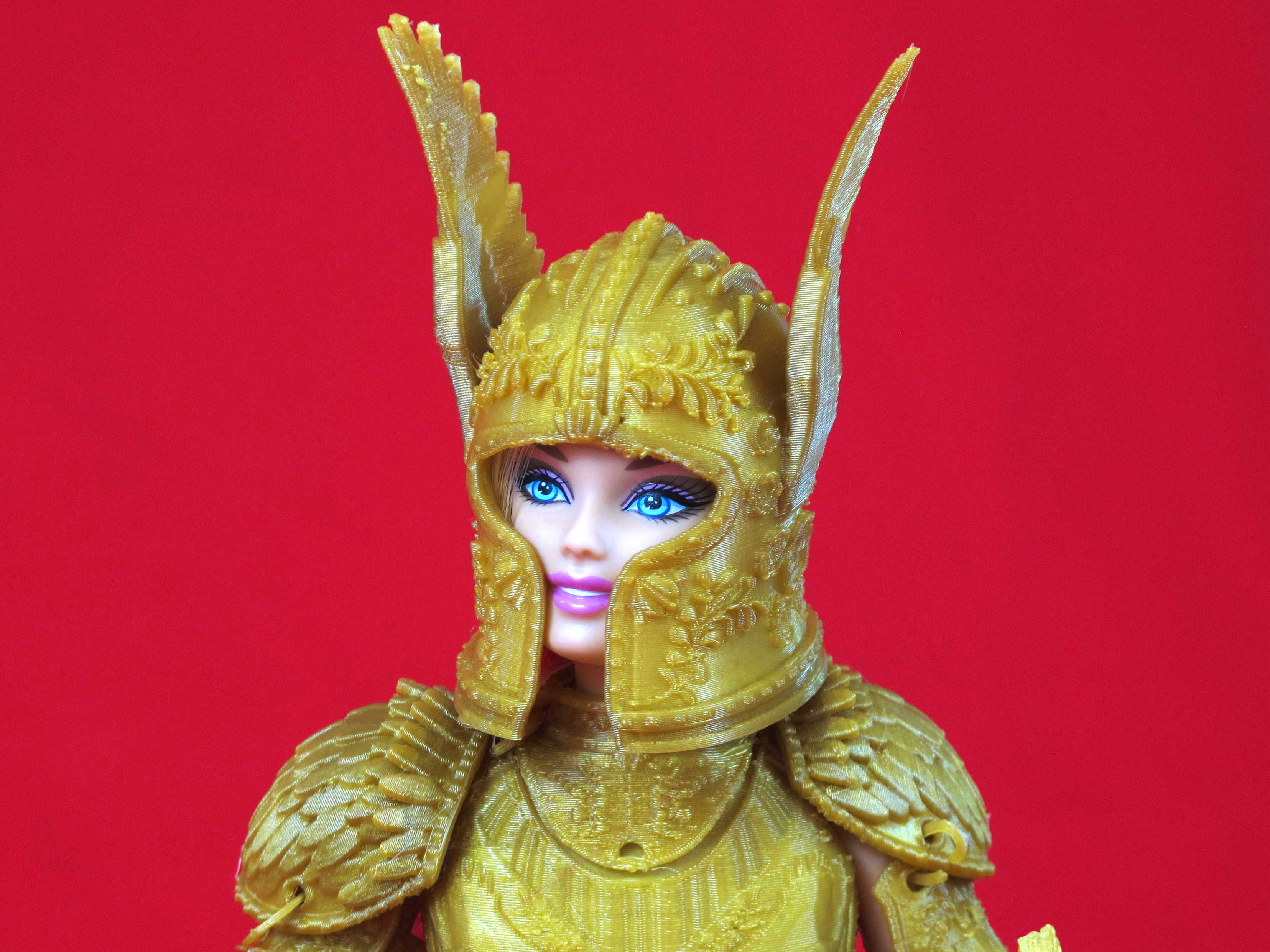 """The helmet of the gold suit of armor in the """"Faire Play"""" battle set. A rose garden pattern is repeated throughout the armor."""