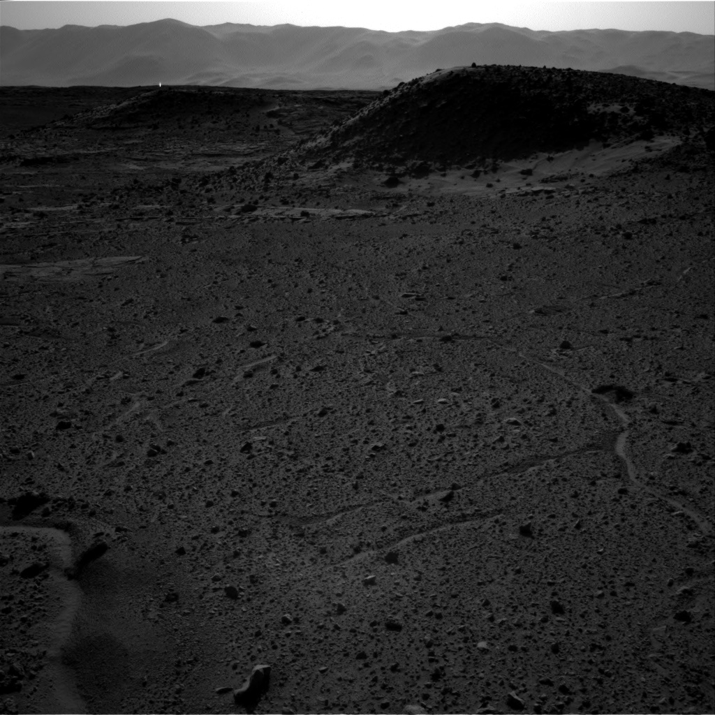 This image from the Navigation Camera (Navcam) on NASA's Curiosity Mars rover includes a bright spot near the upper left corner. The sun is in the same direction, west-northwest, above the frame. Bright spots appear in images from the rover nearly every week. Typical explanations for them are cosmic rays hitting the light detector or sunlight glinting from rocks.