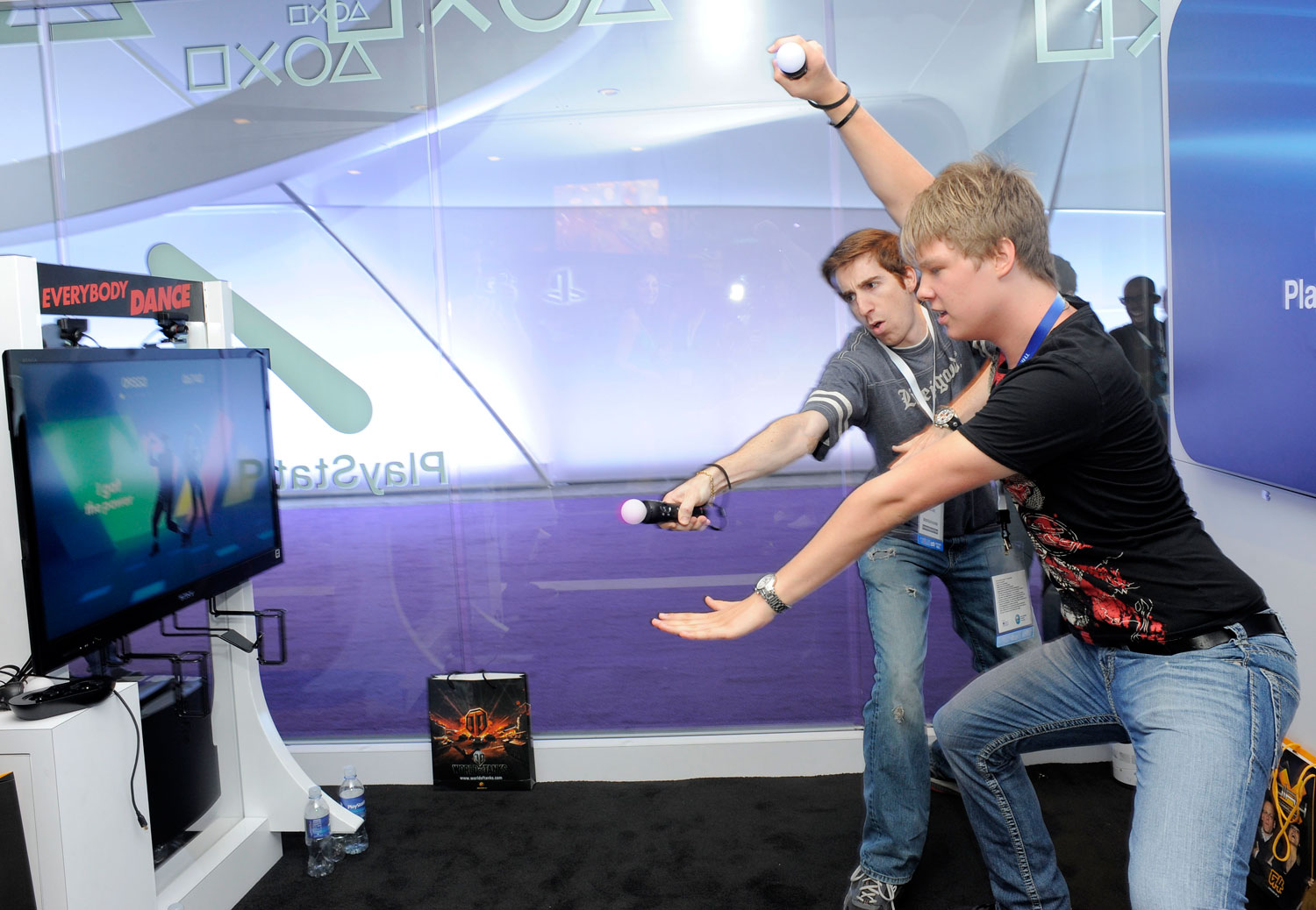 Gamers play with the Playstation Move at the Electronic Entertainment Expo (E3), in Los Angeles on June 9, 2011.