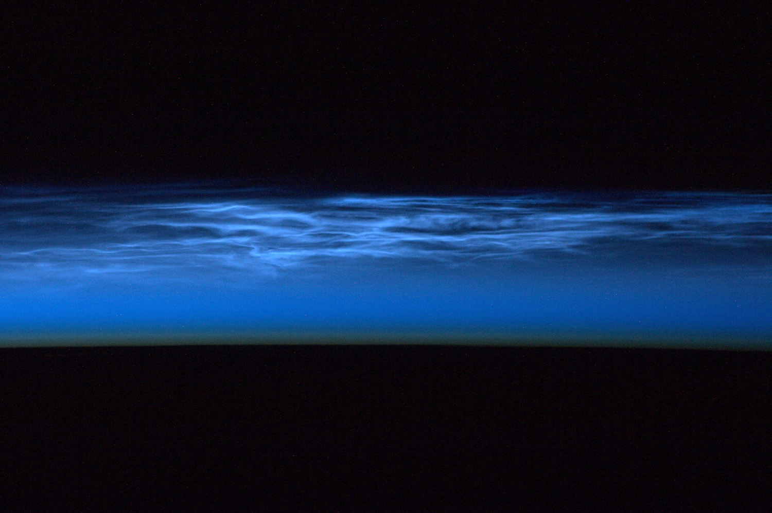 Noctilucent clouds from orbit.                                                              (High altitude clouds at 82 km seen in polar regions.)