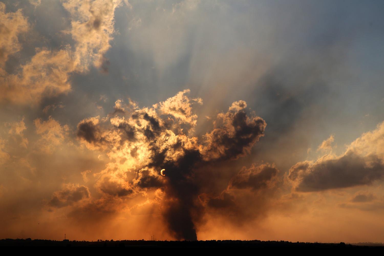 Jul. 20, 2014. Heavy smoke rises over Saja'iah in Gaza following an Israel Air Force bombing, at sunset.