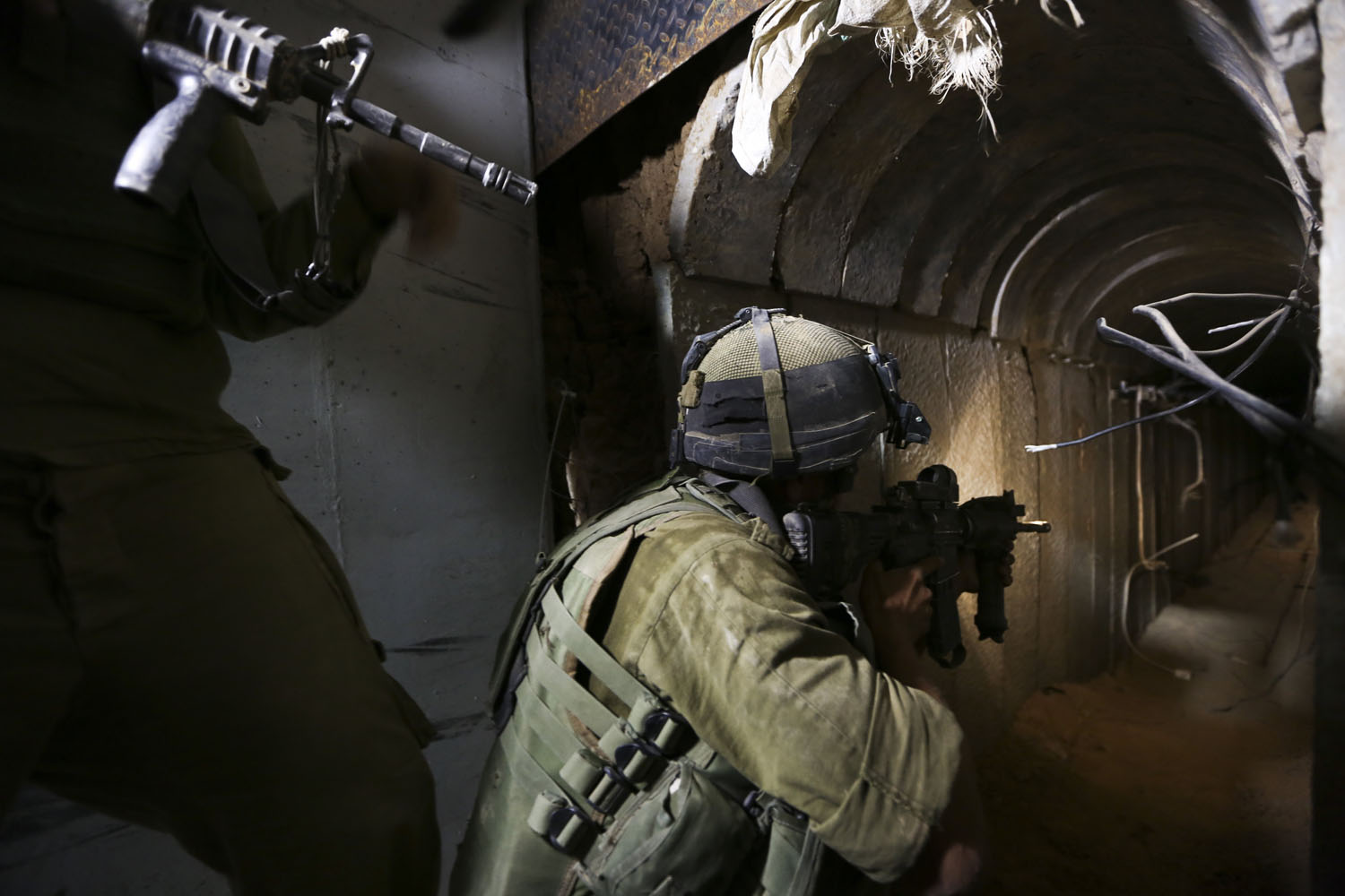 Jul. 30, 2014. Israel Defense Forces soldiers of the Paratroopers Brigade guarding and neutralizing tunnels that were dug by the Hamas organization and leading into Israel.