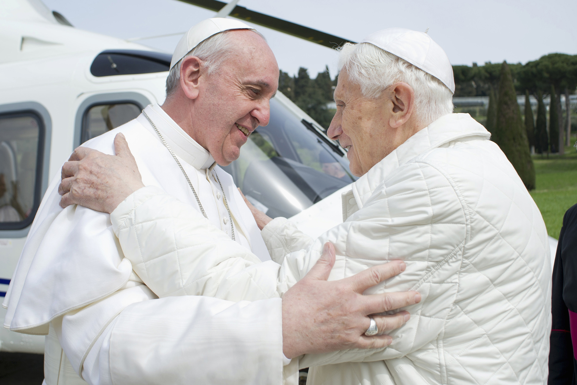 Pope Francis embraces Pope Emeritus Benedict XVI at the Castel Gandolfo summer residence in 2013.