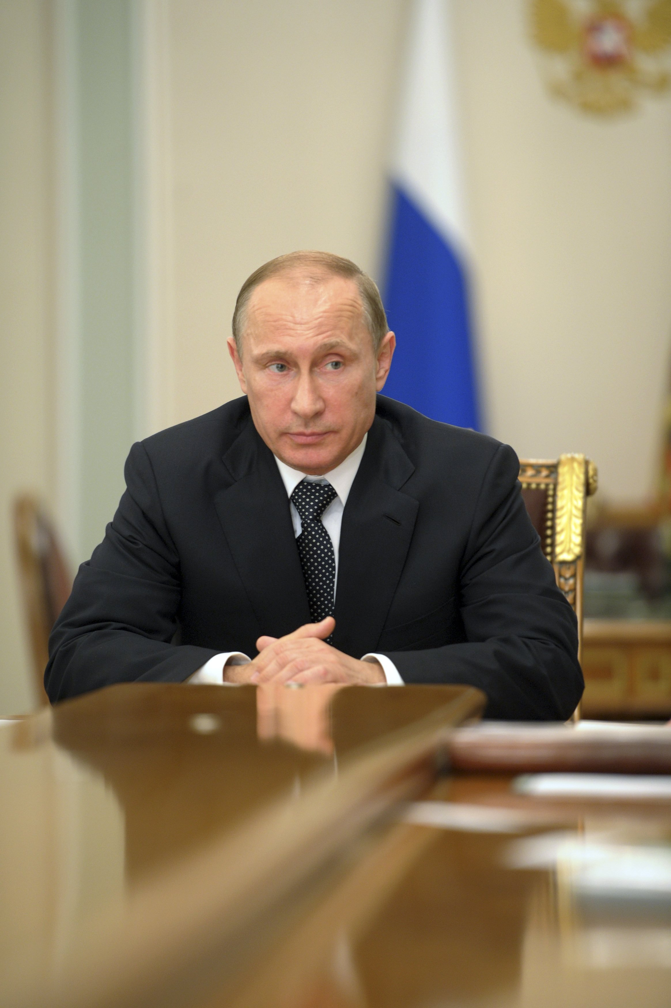 Russia's President Vladimir Putin chairs a meeting at the Novo-Ogaryovo state residence outside Moscow on July 17, 2014.