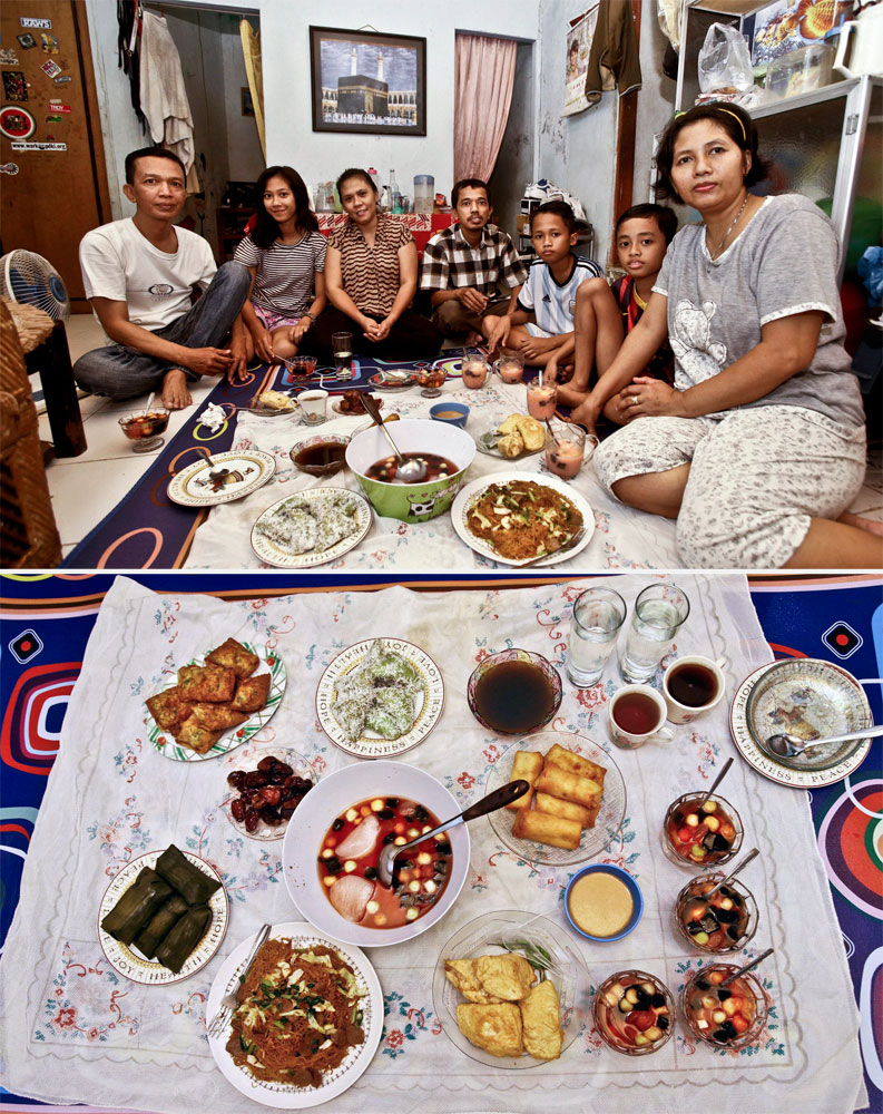 Imam Siswanto (left) waits to break his fast with his family in Jakarta on July 1, 2014.