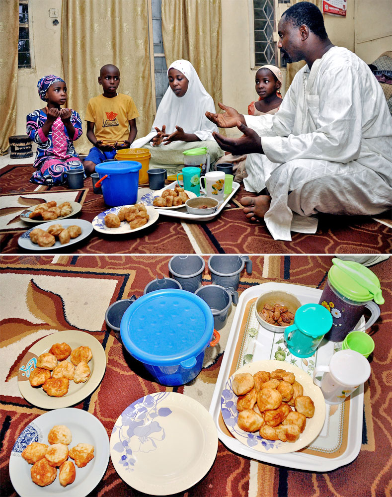 A Muslim family says prayers before breaking their fast in Kano, Nigeria on July 5, 2014.