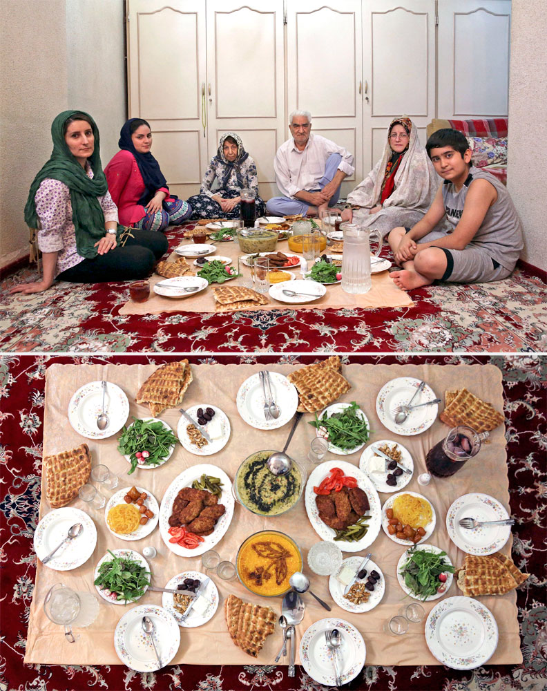 A Muslim family waits to break their fast in Tehran on July 3, 2014.