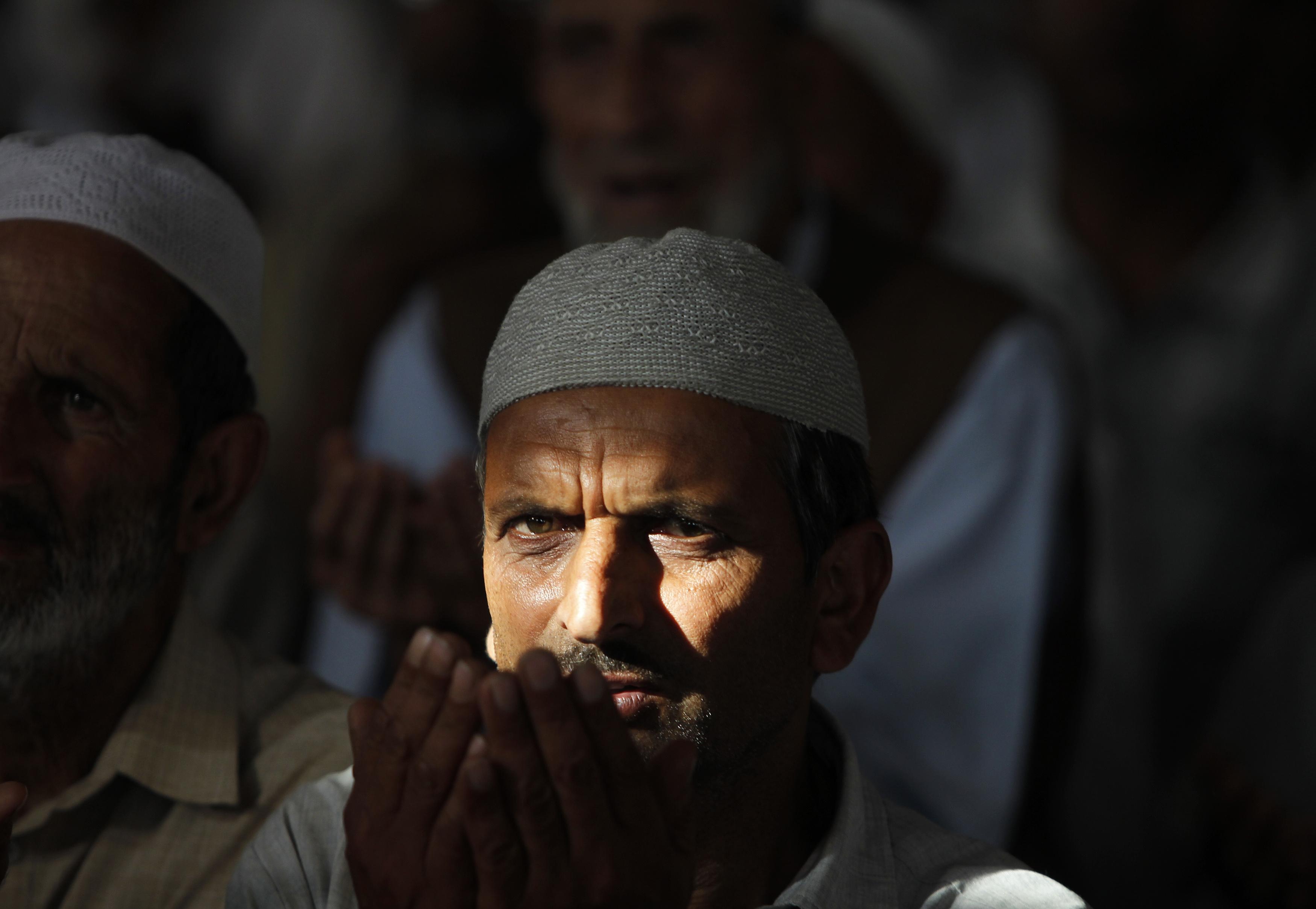 A Kashmiri Muslim man prays inside the shrine of Sheikh Abdul Qadir Jeelani, a Sufi saint, during the holy month of Ramadan in Srinagar, Kashmir on  July 9, 2014.