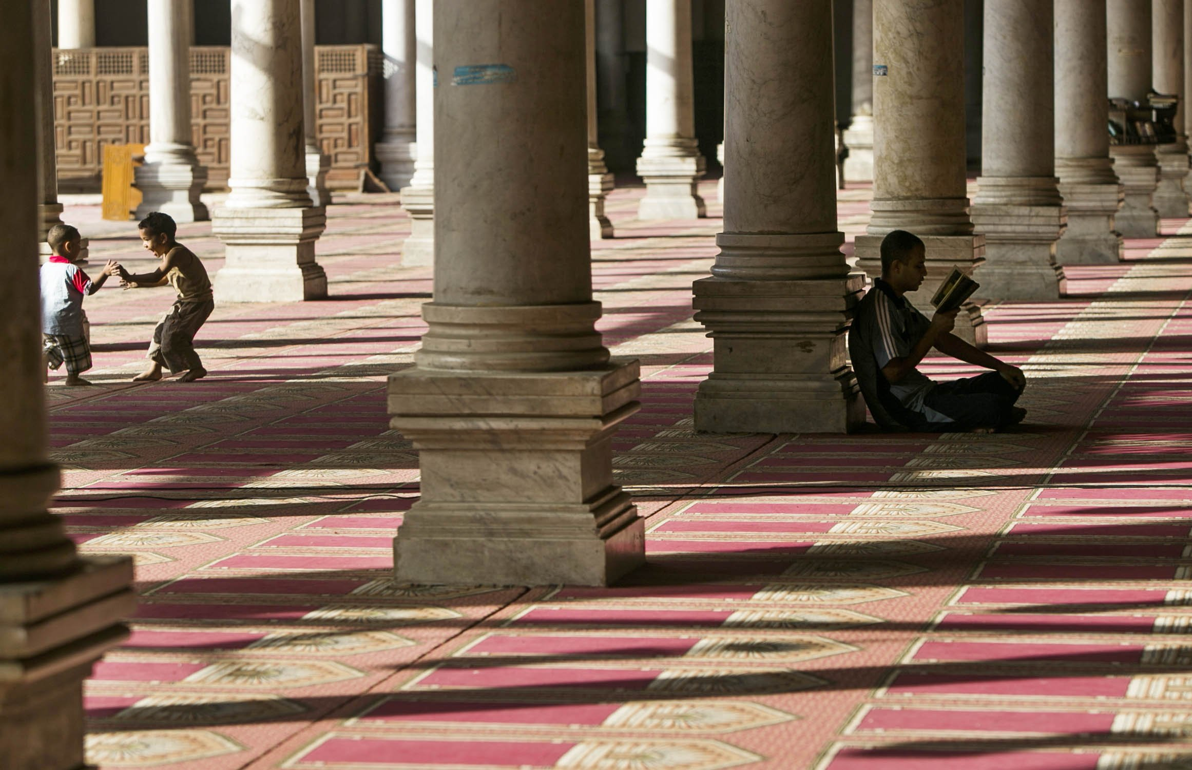 Egyptian children have fun inside a mosque during their fasting hours in a Ramadan afternoon in Cairo June 23, 2014.
