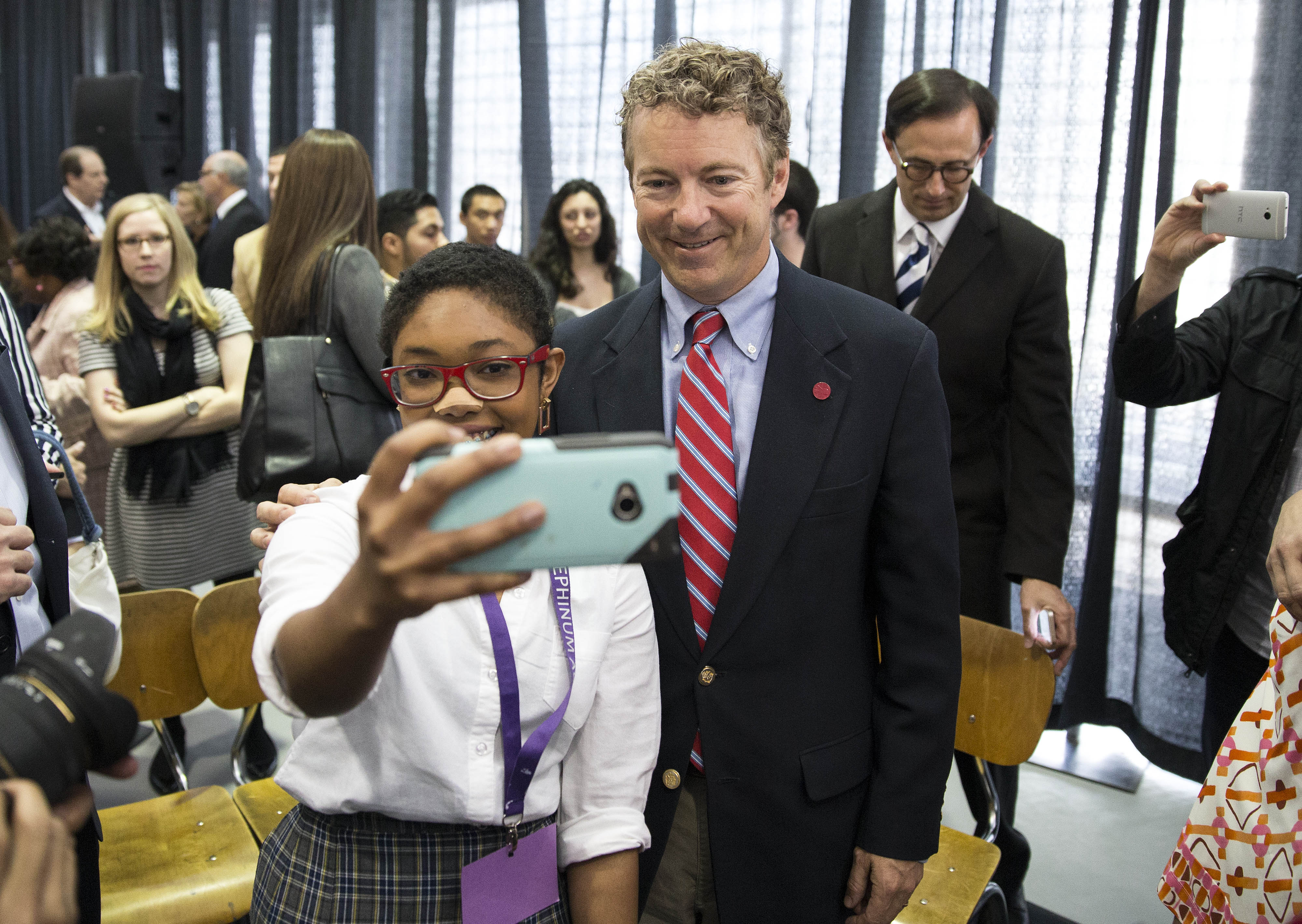 Angelika Noel, 17, poses with Sen. Rand Paul, R-Ky., during a visit to Josephinum Academy in Chicago in April of 2014.