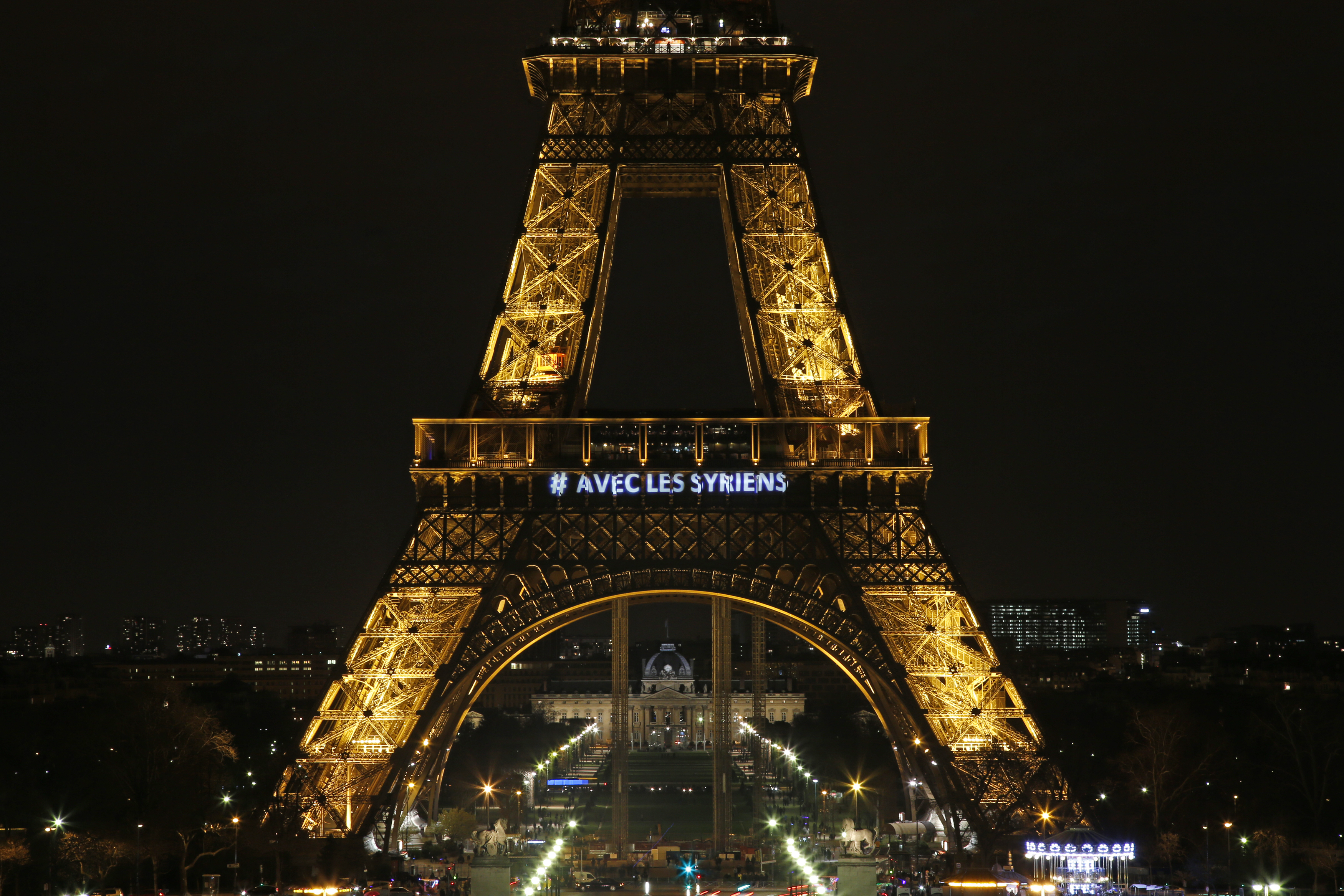 The words  With the Syrians  are displayed on the Eiffel Tower in Paris on March 15, 2014, in support of Syrians on the third anniversary of the conflict that has claimed more than 140,000 lives. On July 9, 2014, French police revealed transcripts of encrypted messages from a French jihadist who planned to target the Eiffel Tower and other French landmarks.