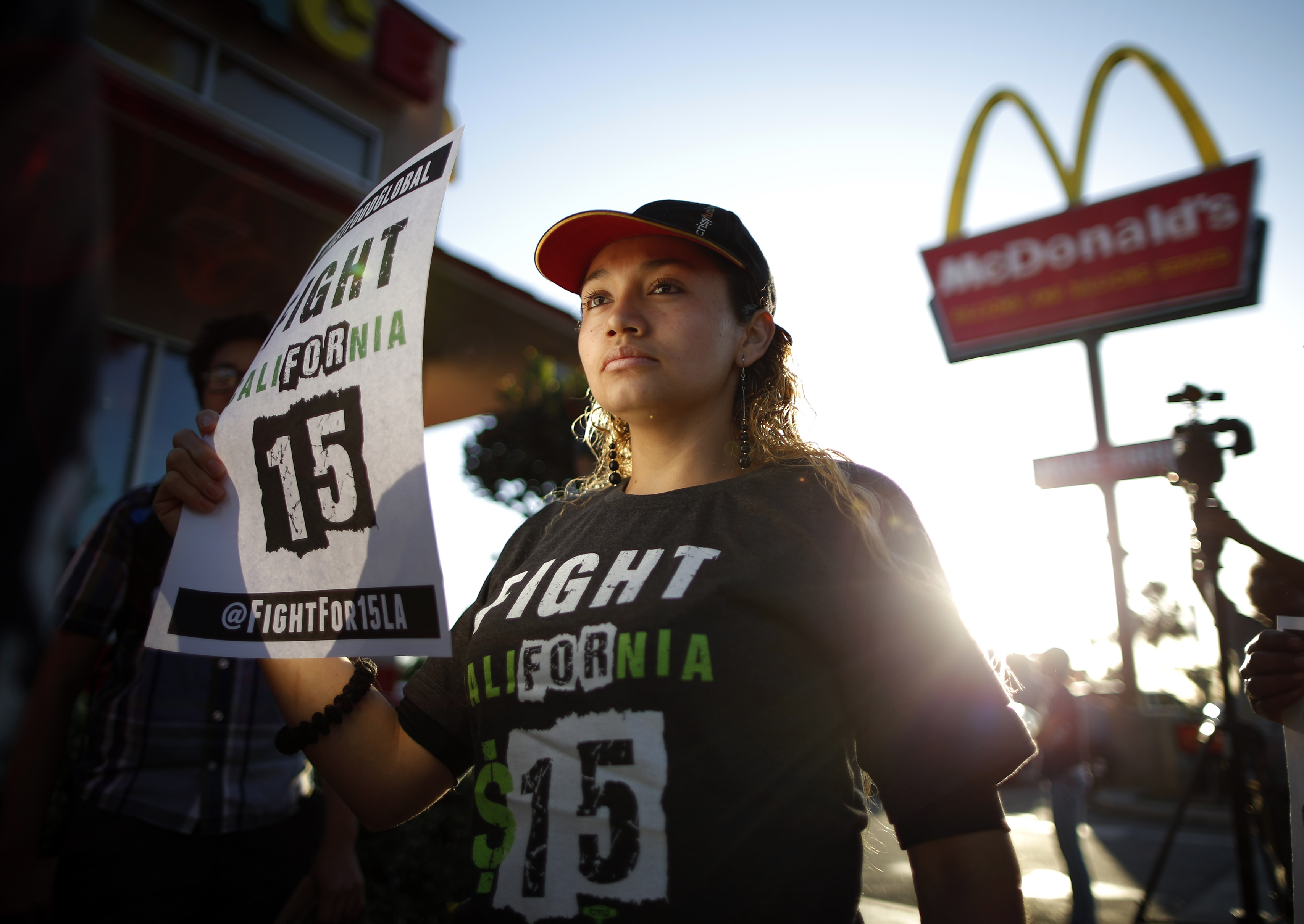 Demonstrators take part in a protest to demand higher wages for fast-food workers outside McDonald's in Los Angeles on May 15, 2014.
