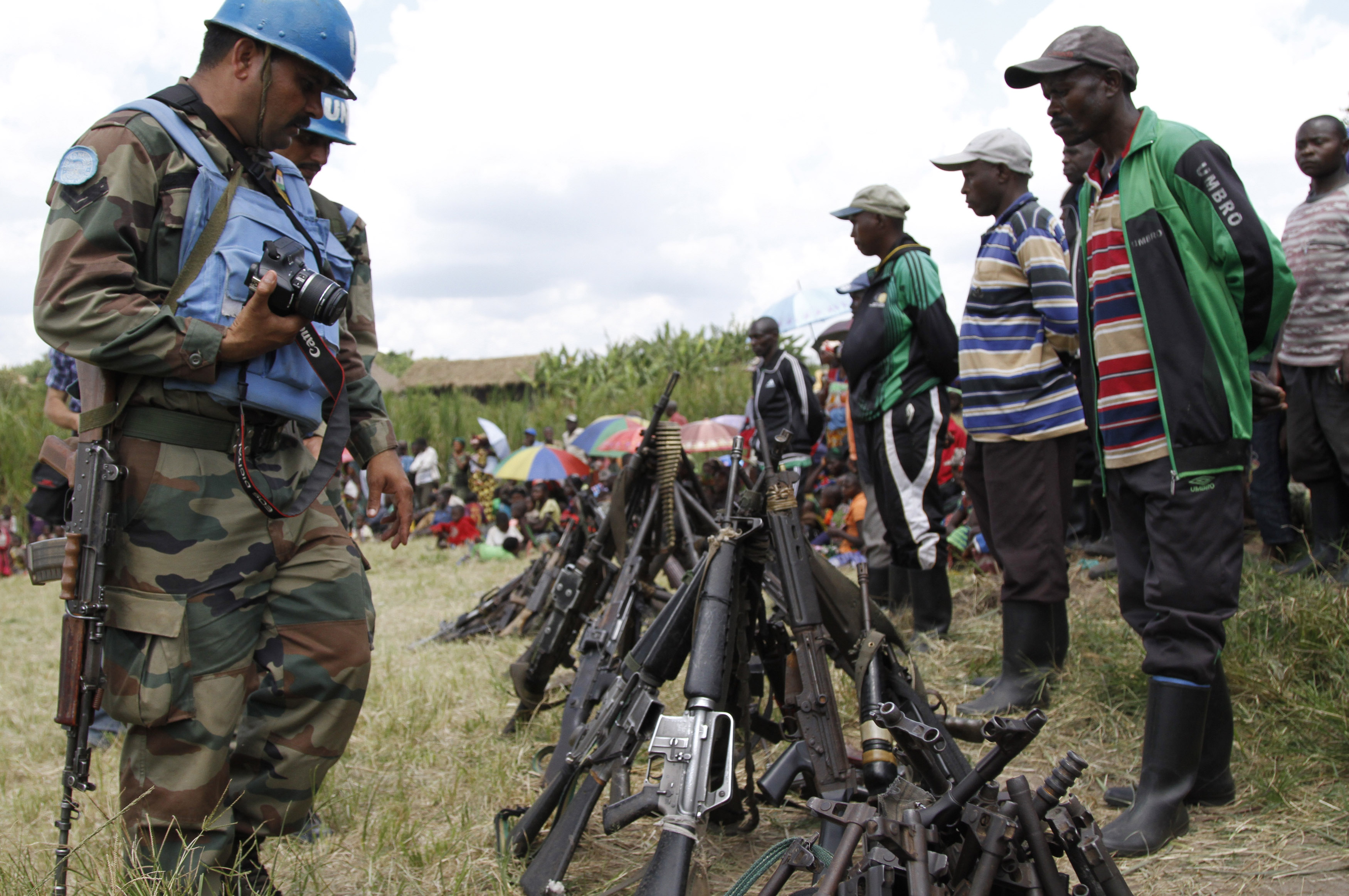 U.N. peacekeepers record details of weapons recovered from the Democratic Forces for the Liberation of Rwanda militants after their surrender in Kateku, a small town in the eastern region of the Democratic Republic of Congo on May 30, 2014.
