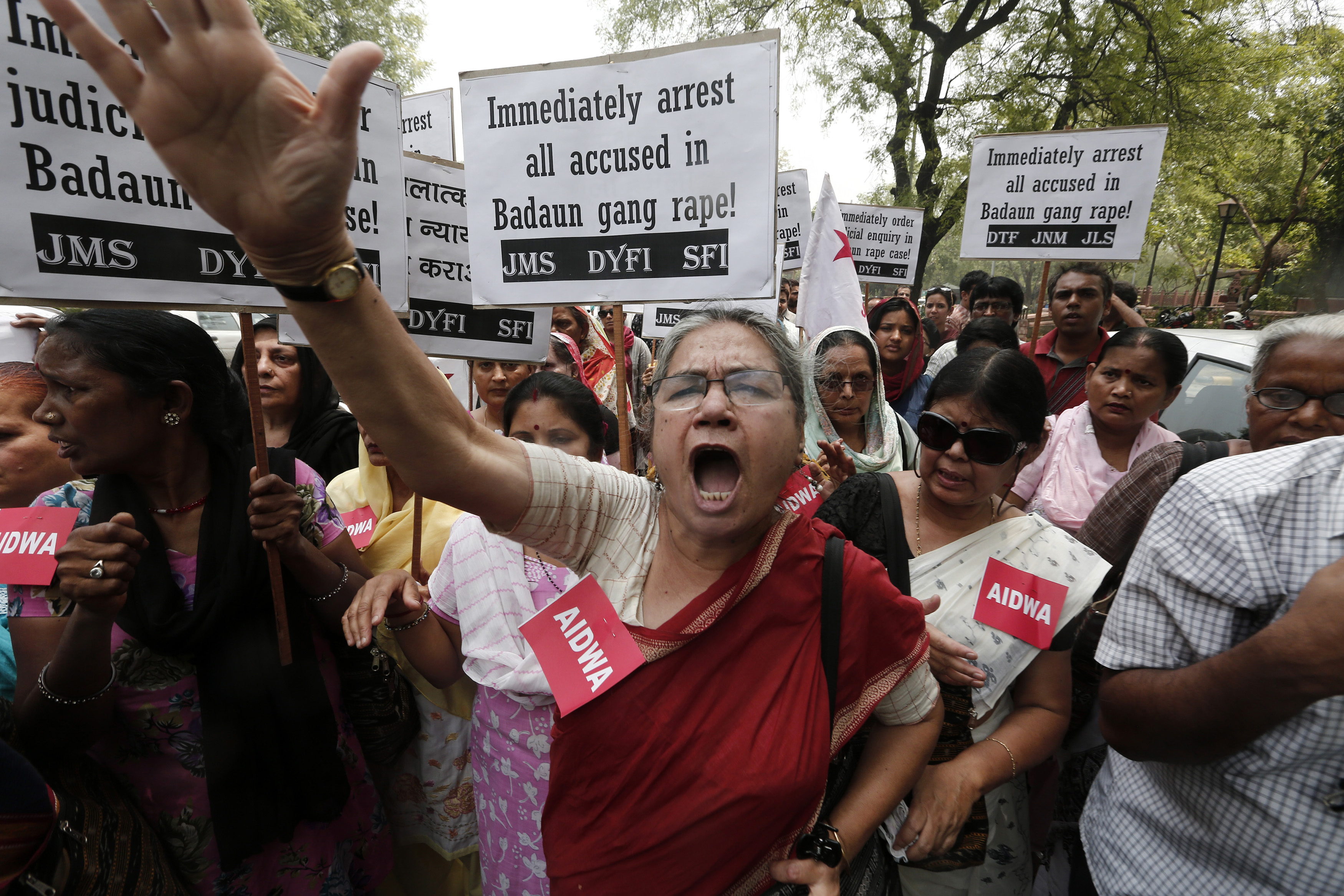 Demonstrators from All India Democratic Women's Association hold placards and shout slogans in New Delhi on May 31, 2014, during a protest against the recent killings of two teenage girls