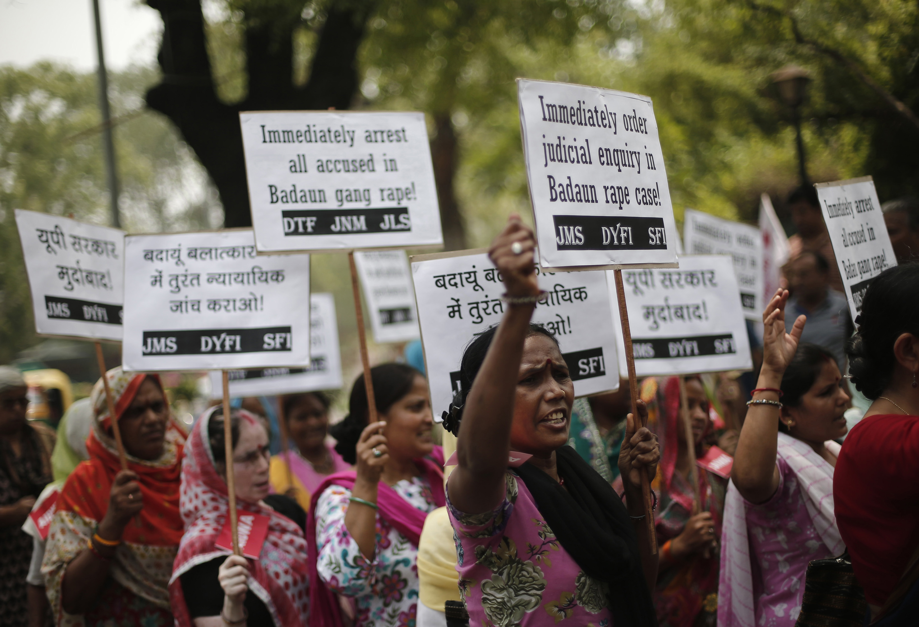 Demonstrators from the All India Democratic Women's Association hold placards and shout slogans during a protest against the rape and murder of two teenage girls, in New Delhi on May 31, 2014