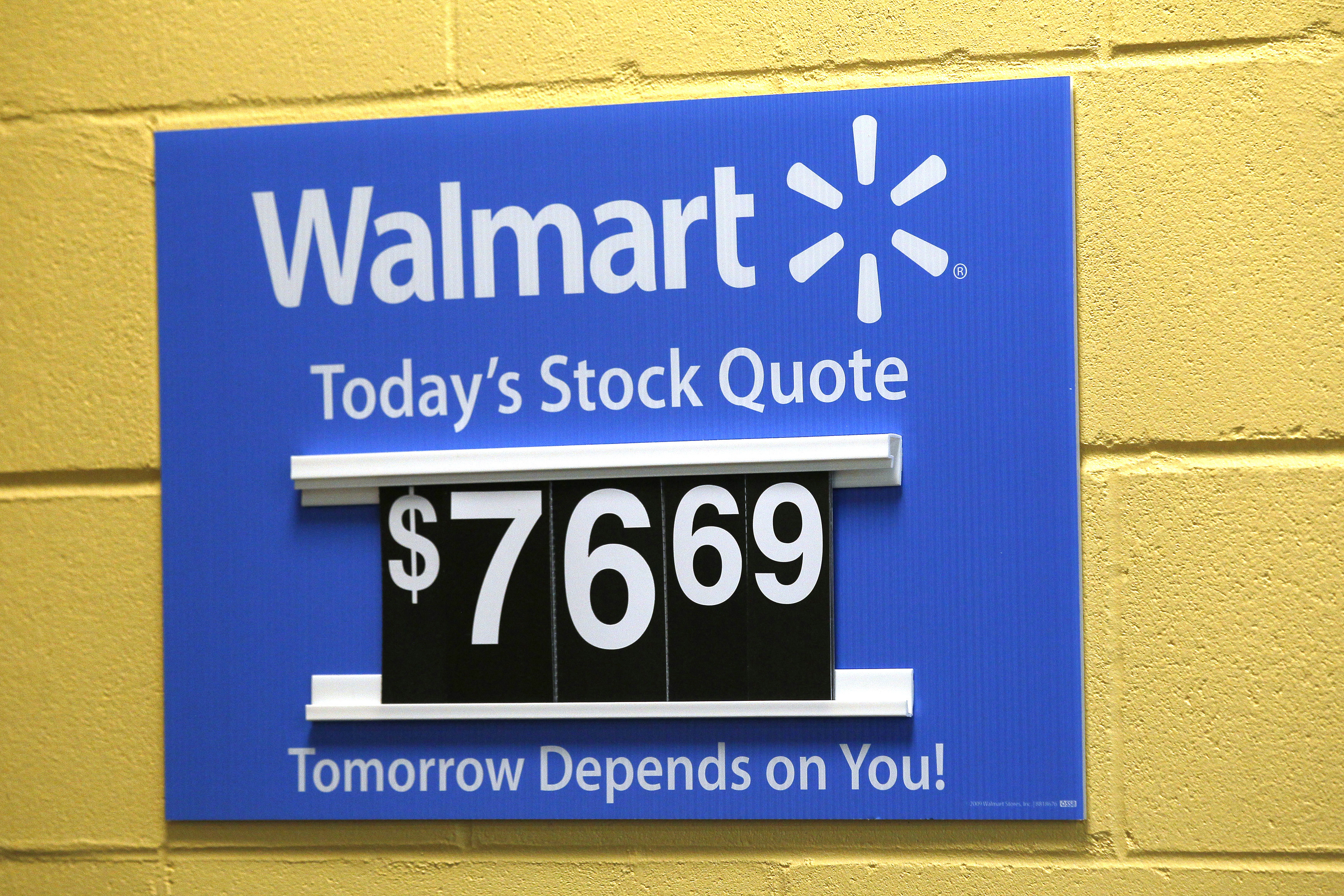 A sign lists the current Walmart stock price at the Walmart Supercenter in Bentonville, Ark., on June 5, 2014