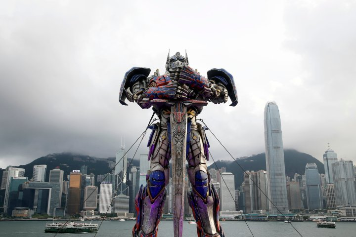 """A 21-foot tall model of the Transformers character Optimus Prime is displayed on the red carpet before the world premiere of the film """"Transformers: Age of Extinction"""" in Hong Kong"""