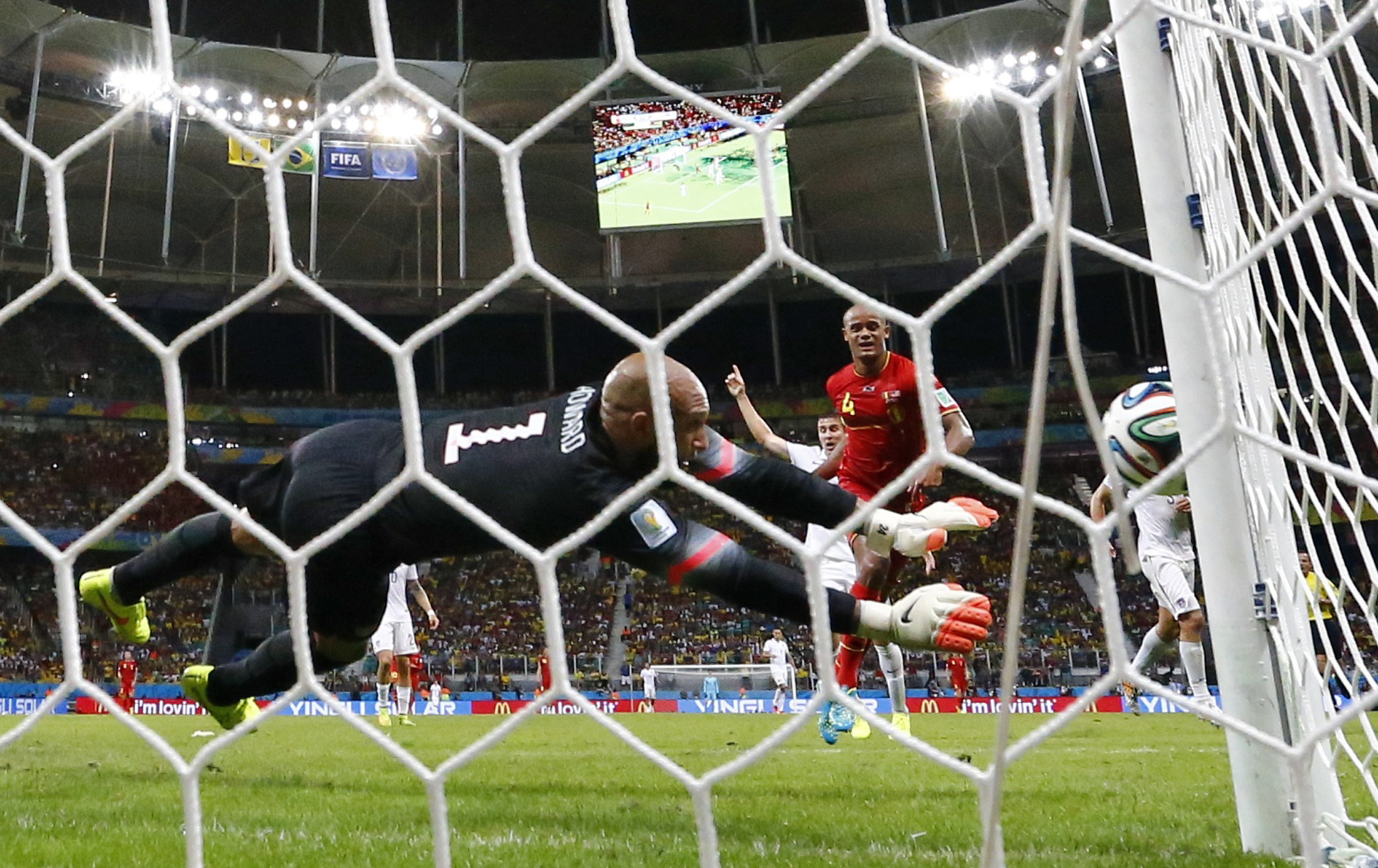 U.S. Goalkeeper Tim Howard blocks a shot from Belgium's Vincent Kompany during their World Cup match at the Fonte Nova arena in Salvador, Brazil, on July 1, 2014