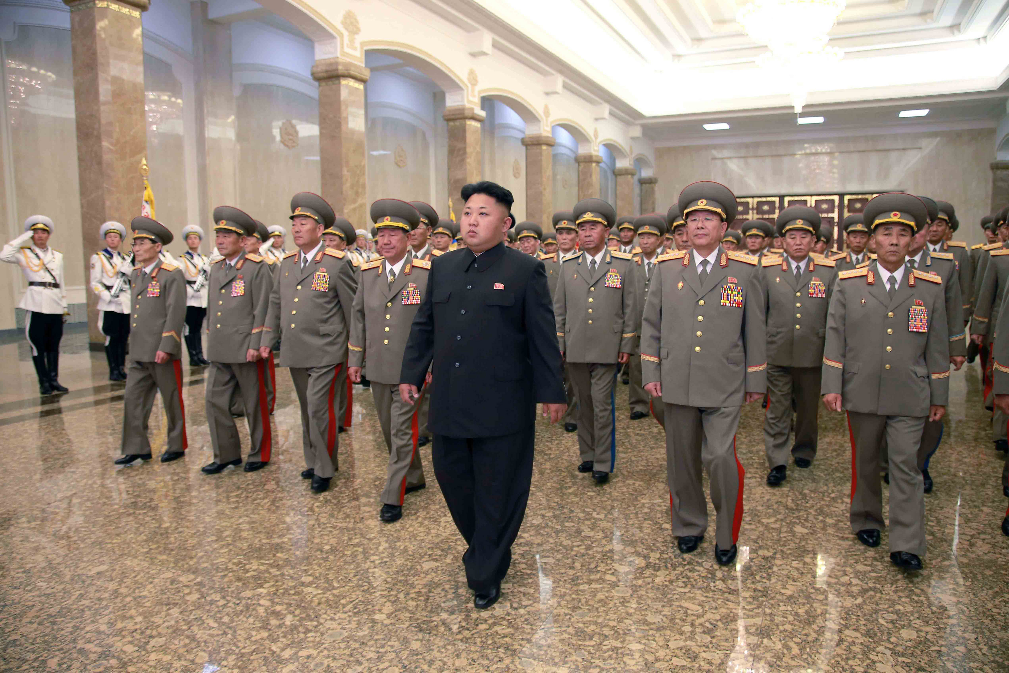North Korean leader Kim Jong Un visits the Kumsusan Palace of the Sun in Pyongyang at midnight on July 8, 2014.