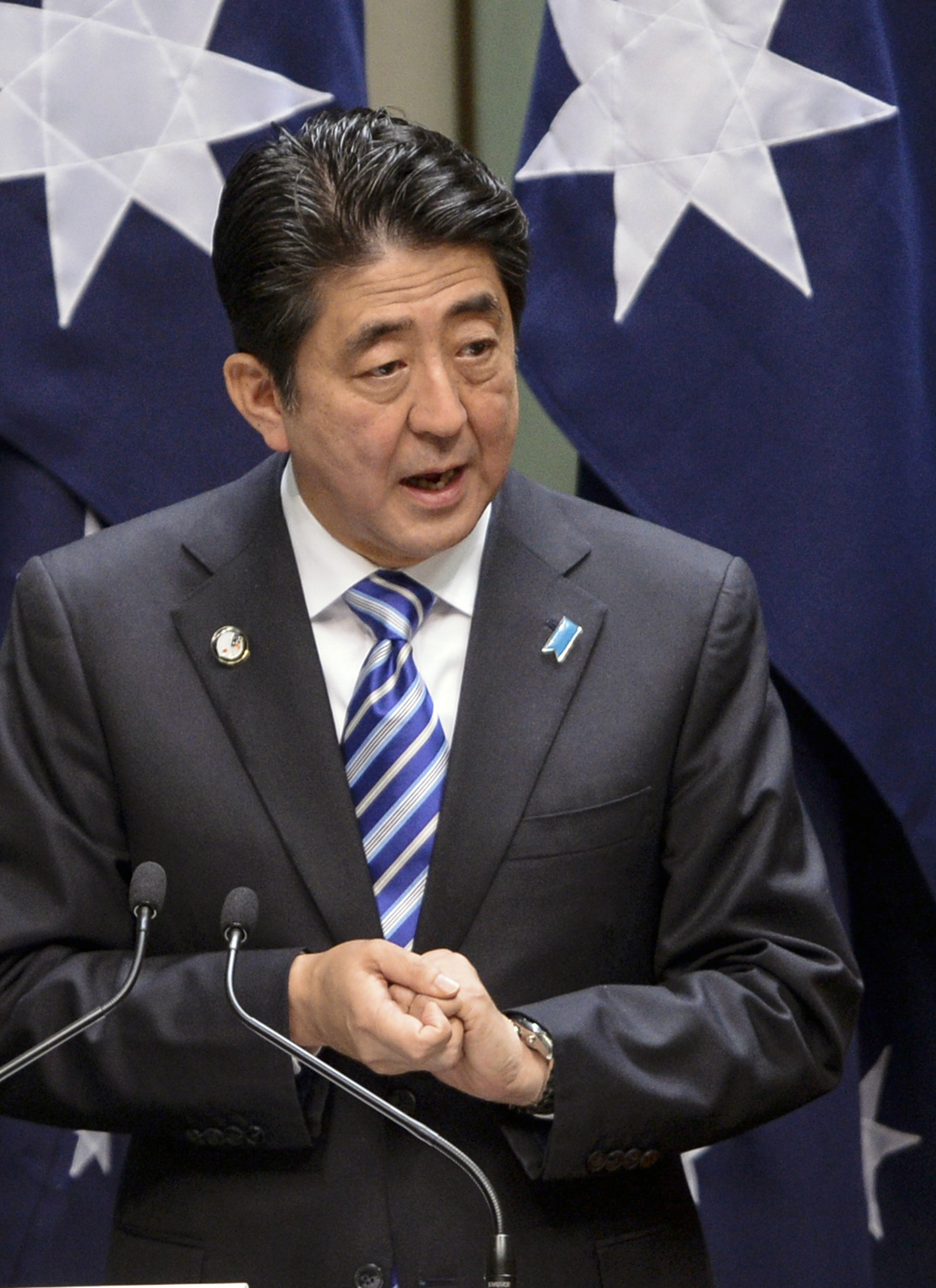 Japan's Prime Minister Shinzo Abe delivers an address to both houses of parliament in Australia's House of Representatives chamber at Parliament House in Canberra July 8, 2014.