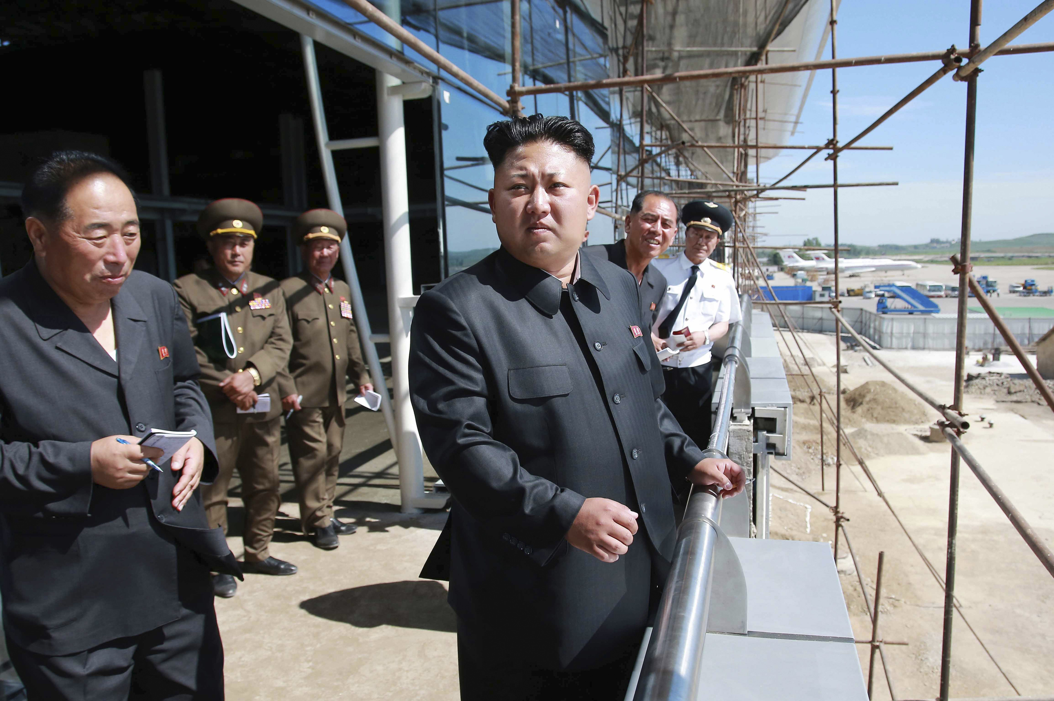 North Korean leader Kim Jong Un pays a visit to the construction site of a terminal at Pyongyang International Airport in this undated photo released by North Korea's Korean Central News Agency (KCNA) in Pyongyang on July 11, 2014.