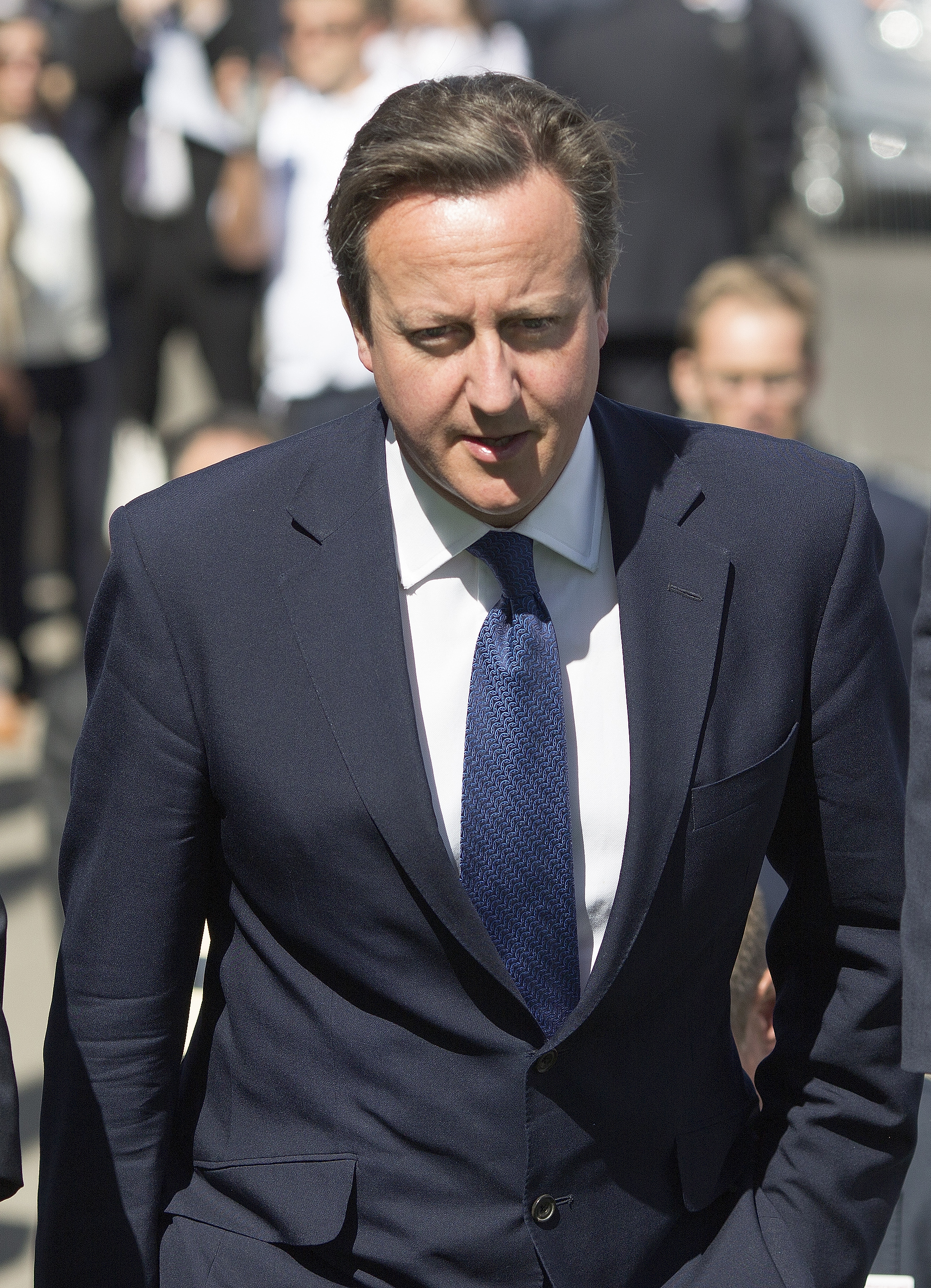 Britain's Prime Minister David Cameron arrives to officially open the 2014 Farnborough International Airshow, in southern England, on July 14, 2014
