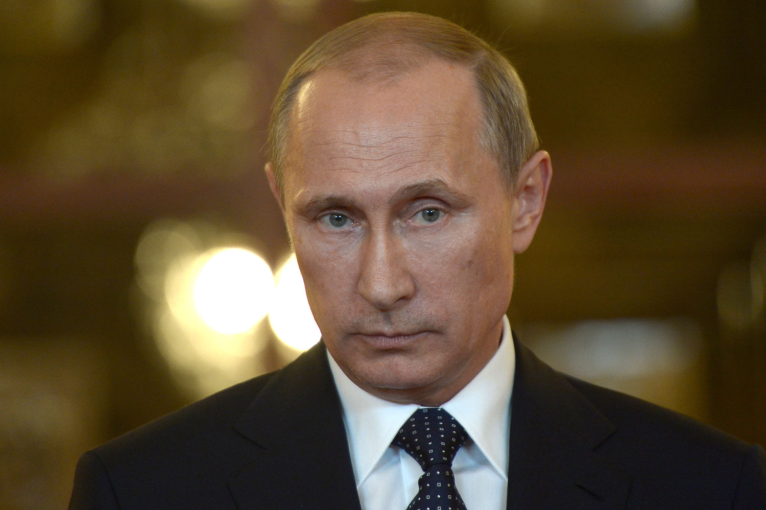 Russia's President Vladimir Putin talks to reporters during a meeting in Brasilia, July 16, 2014.