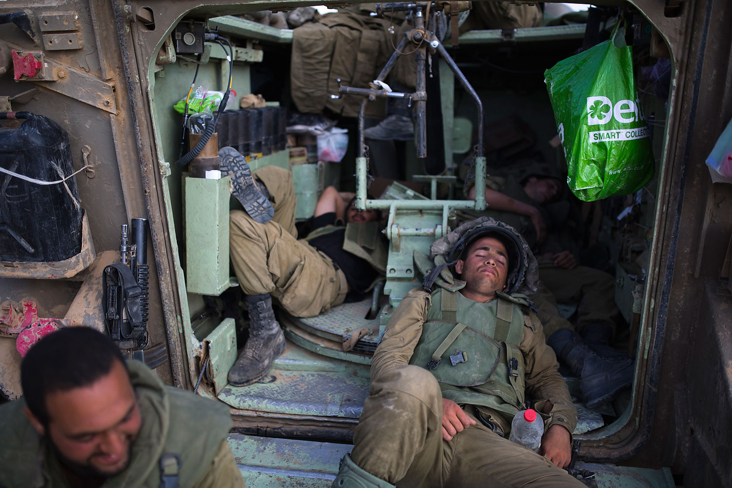 Israeli soldiers rest inside an armoured personnel carrier outside central Gaza Strip July 19, 2014.