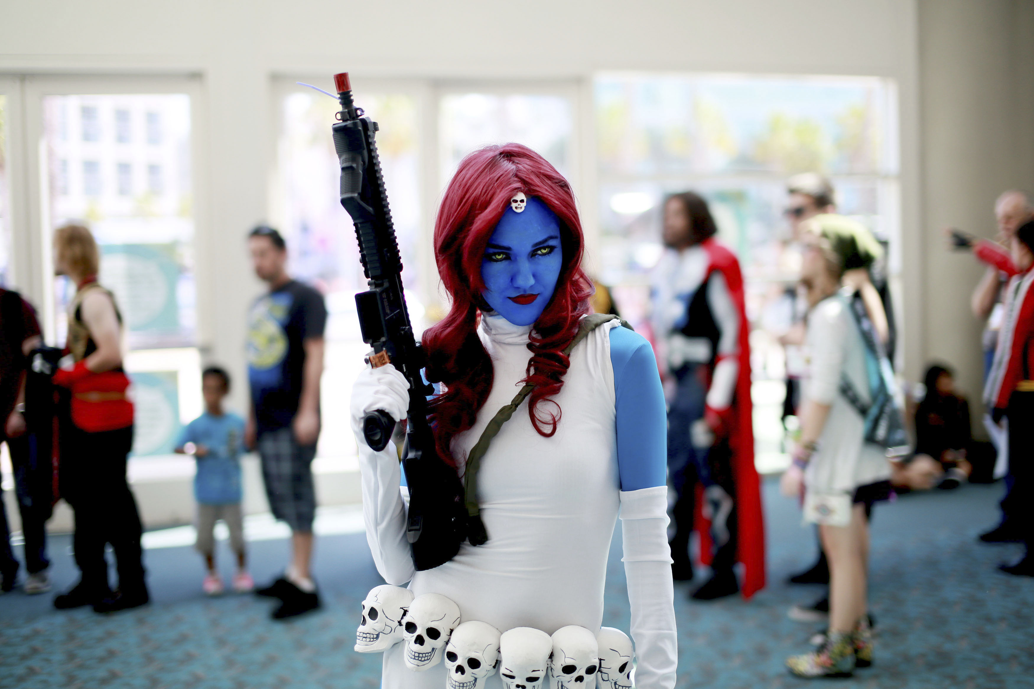 Allie Shaughnessy, who is dressed as Mystique, poses during the 2014 Comic-Con International Convention in San Diego on July 24, 2014.
