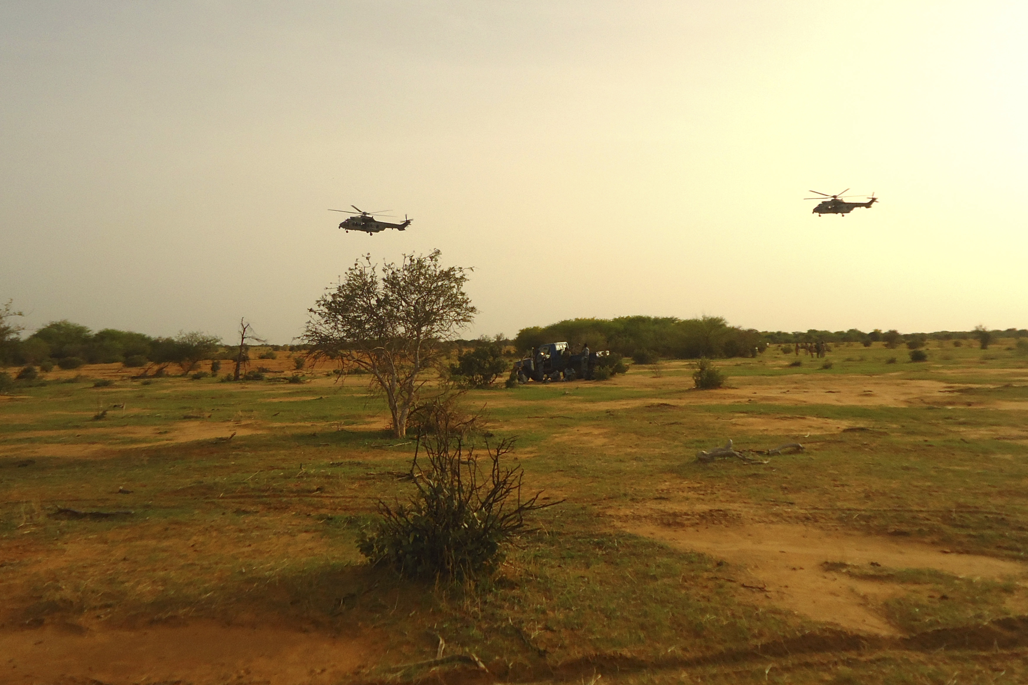 French military helicopters fly above the crash site of Air Algérie Flight 5017 near the northern Mali town of Gossi on July 24, 2014