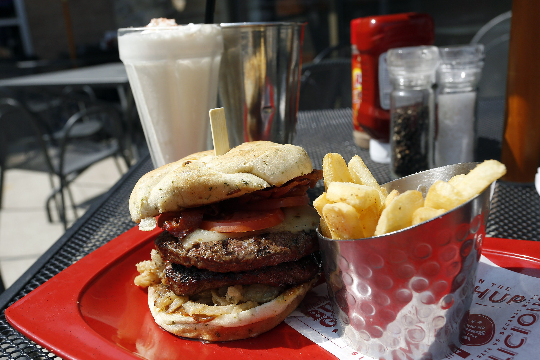 A.1. Peppercorn burger, Bottomless Steak Fries, and Monster Salted Caramel Milkshake is seen at a Red Robin restaurant in Foxboro, Massachusetts July 30, 2014.