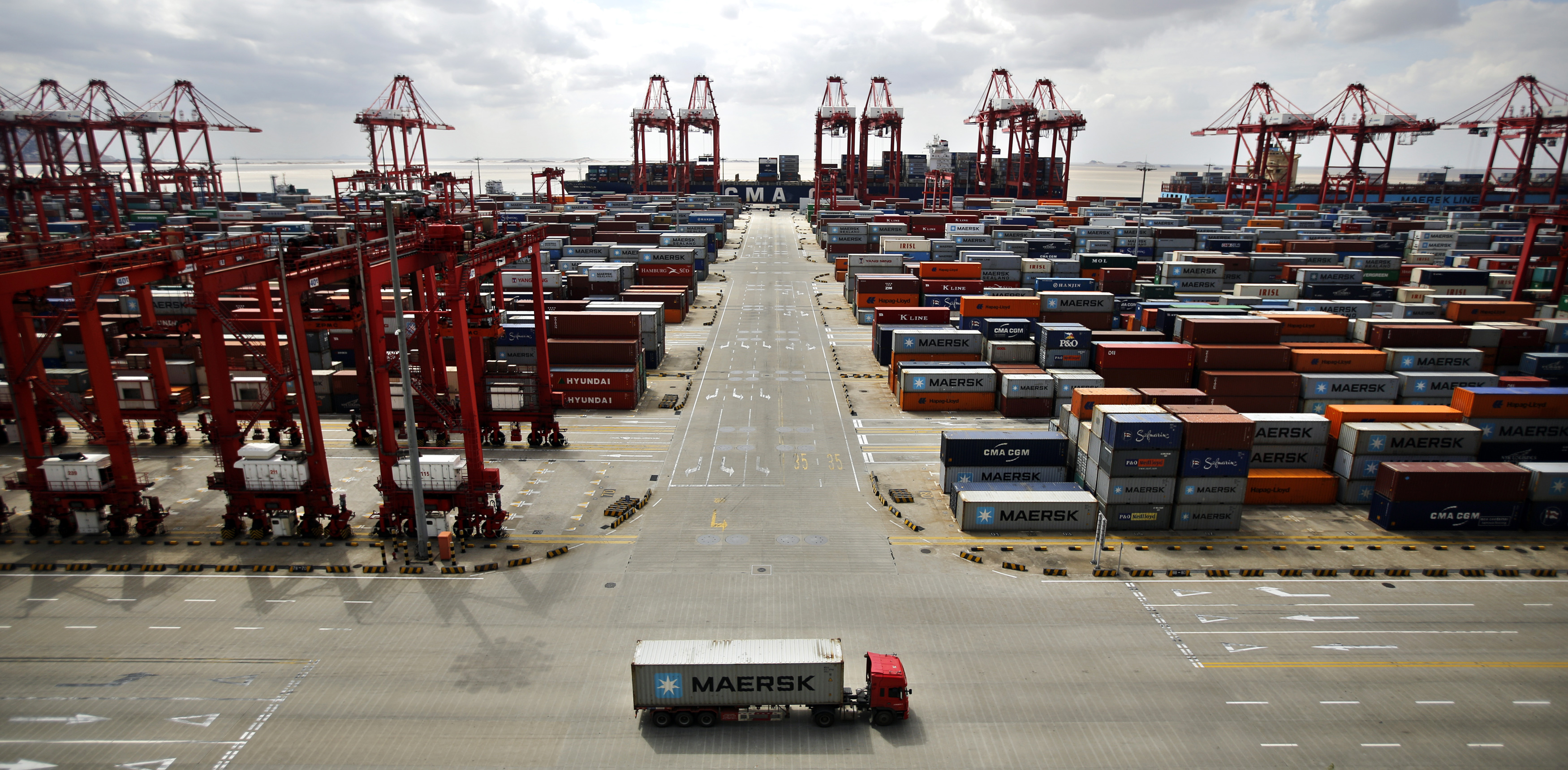 A container truck drives past the container area at the Yangshan Deep Water Port, part of the Shanghai Free-Trade Zone, on Sept. 26, 2013