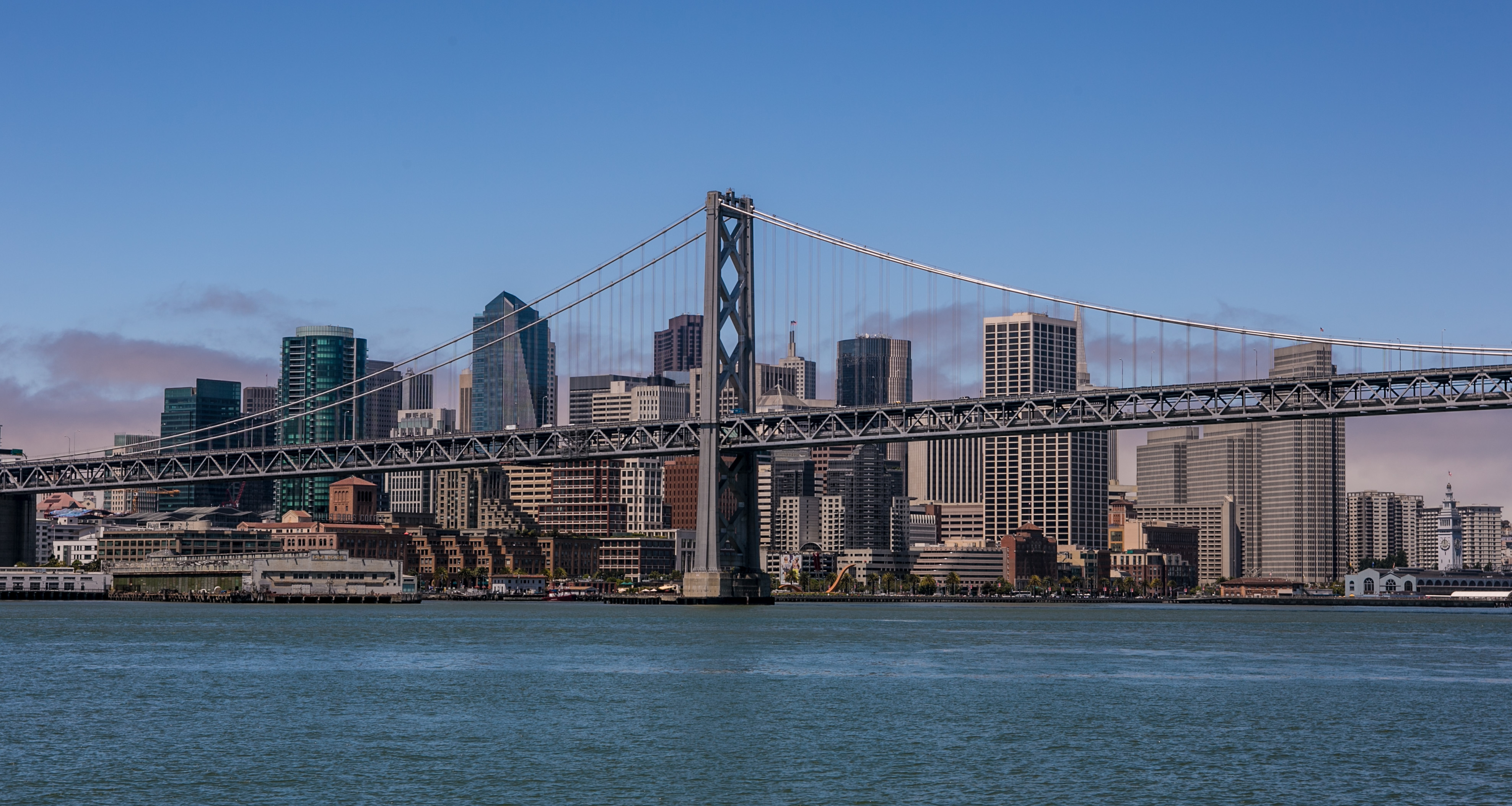 The downtown San Francisco skyline and Bay Bridge are shown during a 30-minute ferry ride across to AT&T Park on July 10, 2013, in San Francisco.
