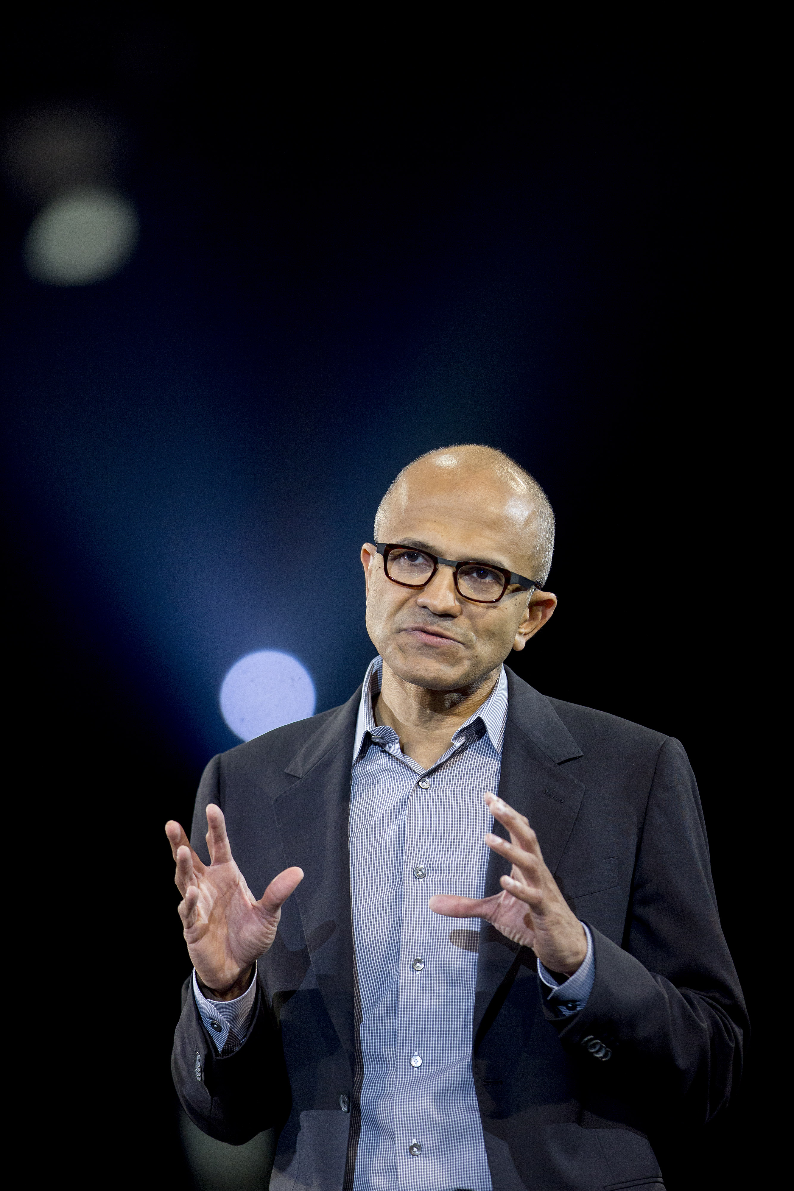 Satya Nadella, chief executive officer of Microsoft Corp., speaks during a keynote session at the Microsoft Worldwide Partner Conference in Washington on July 16, 2014.