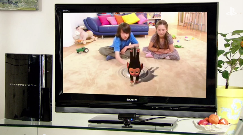 Kids using the PlayStation Eye to interact with a virtual pet in the game EyePet, in Sony's promotional video.